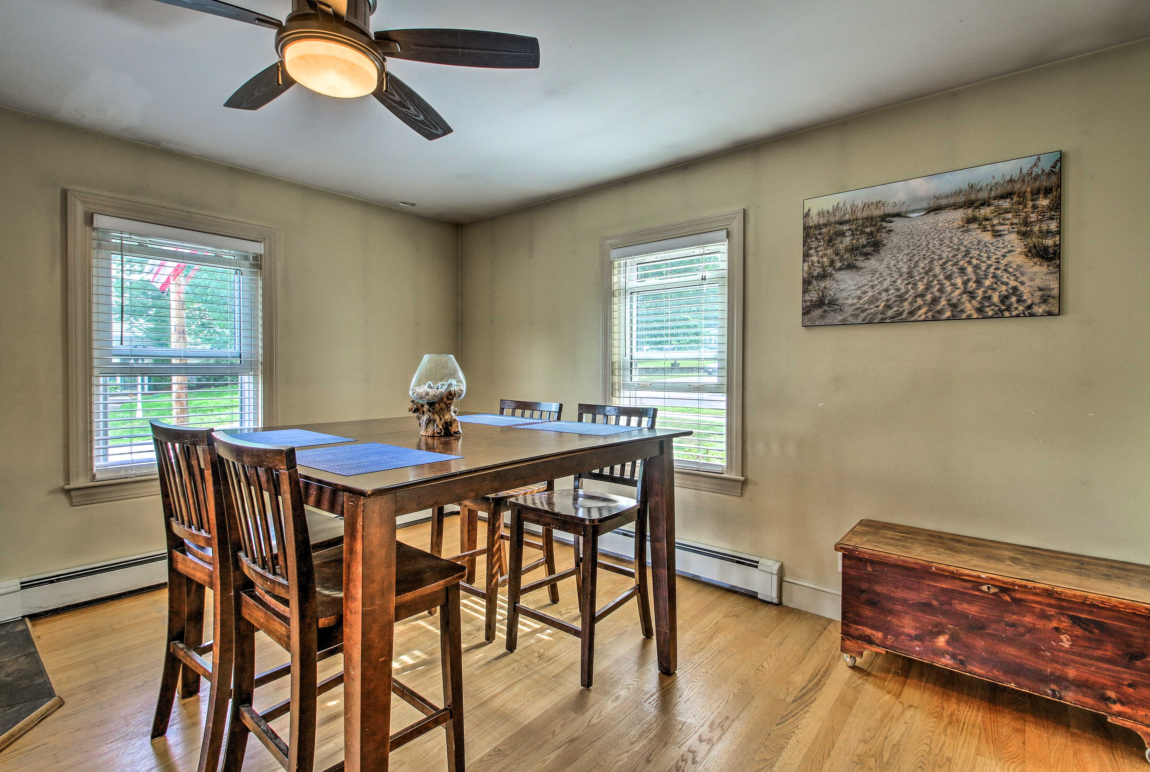 The large wood table is a great size to pull up chairs and dine together.