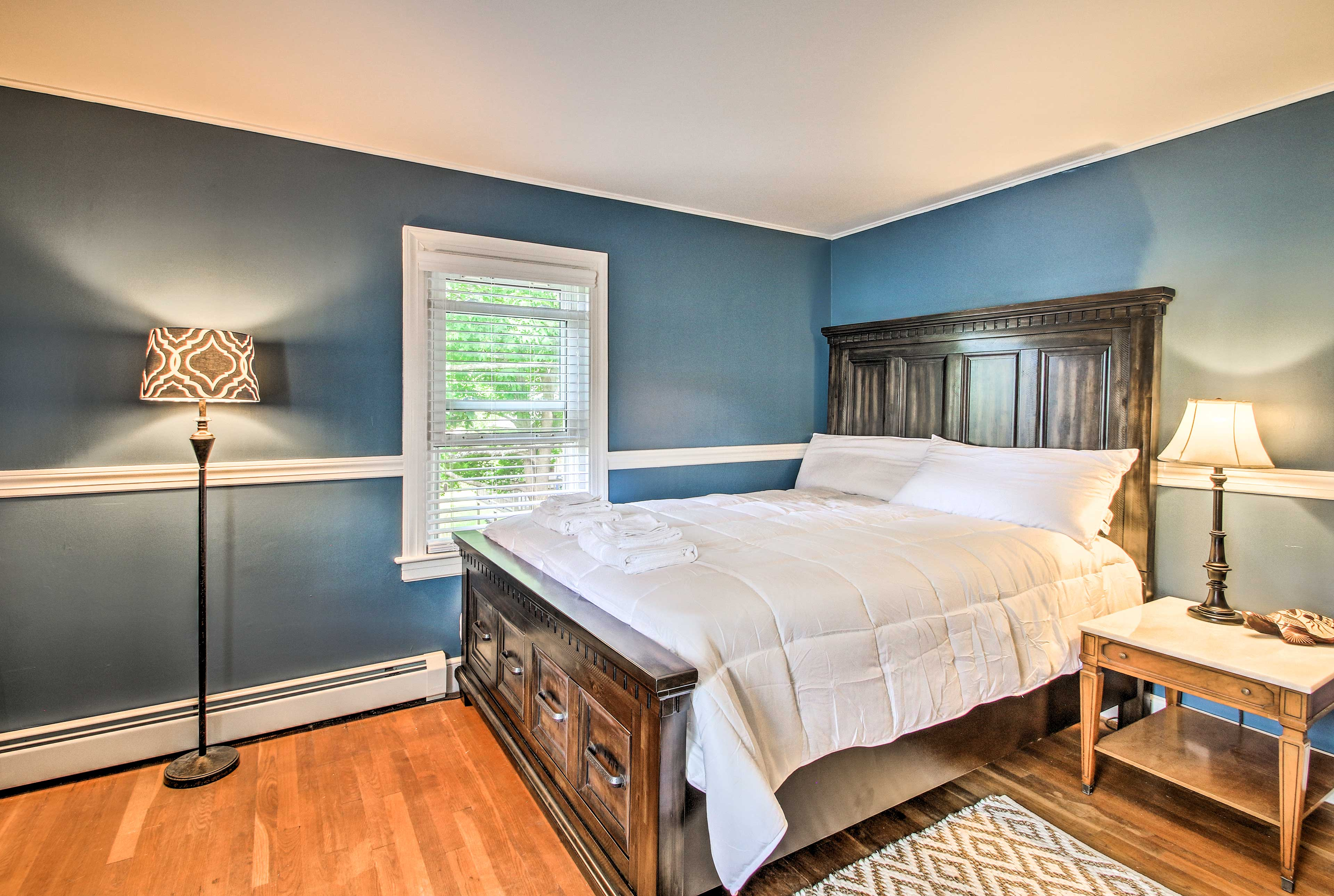 A queen-sized bed fills the lovely second bedroom!