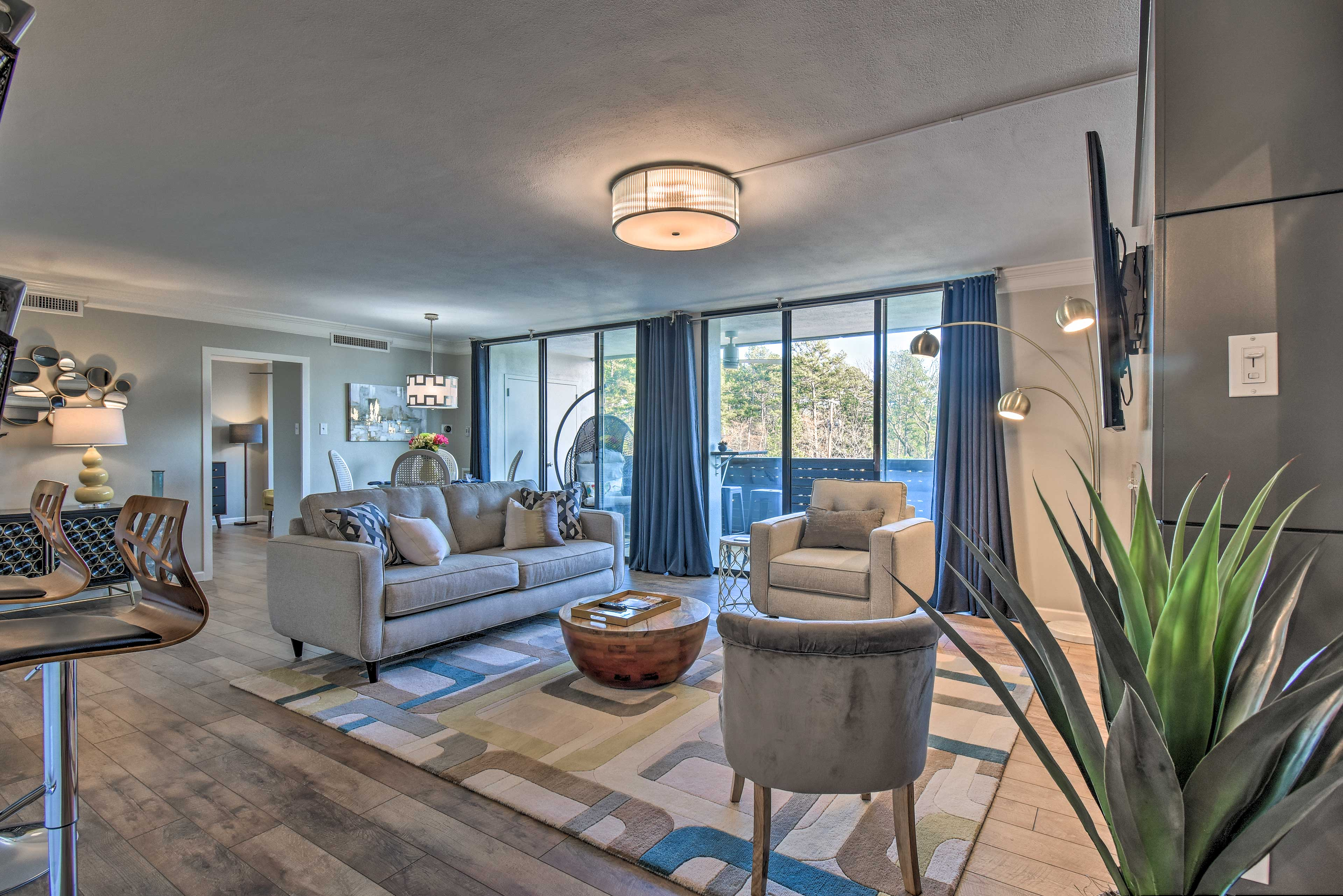 Make yourself at home in the 1,140-square-foot interior boasting tasteful decor.
