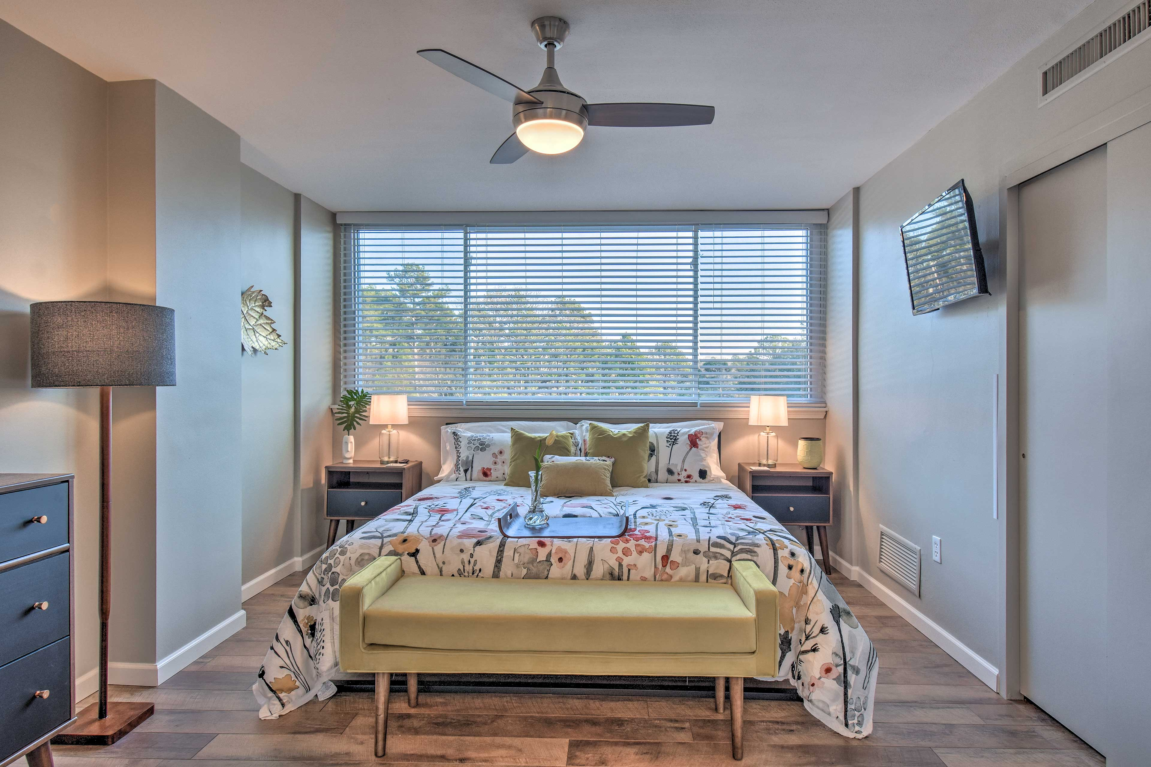 The master bedroom hosts a plush king-sized bed.