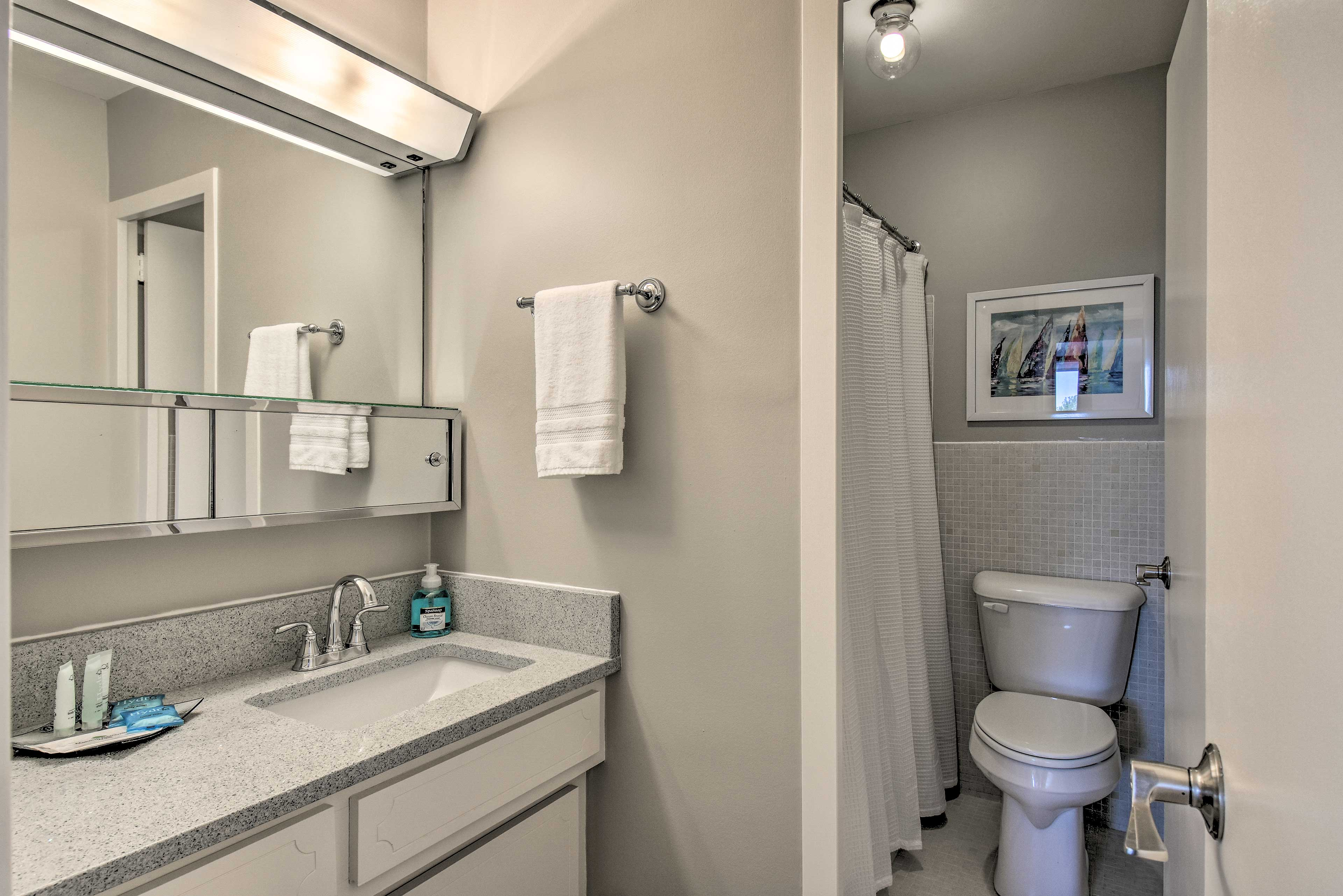 Spread your toiletries out on the ample countertops while you get ready.