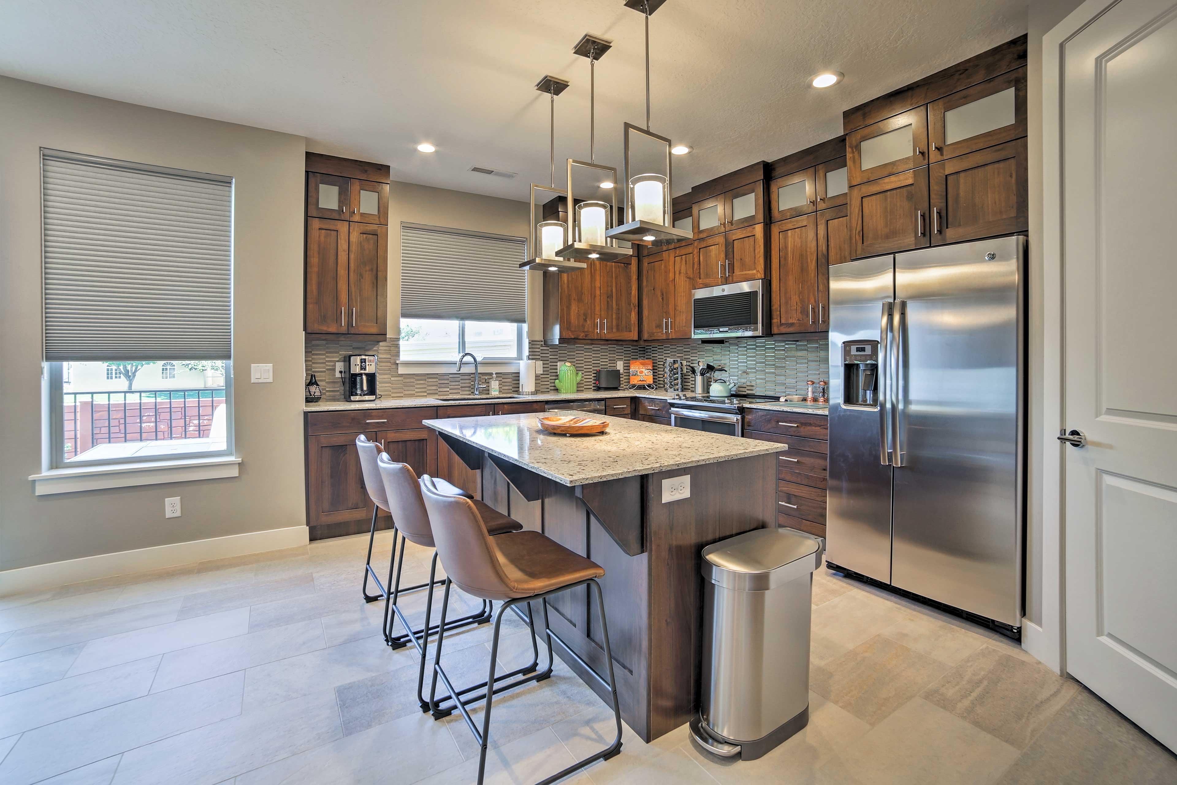 The stunning kitchen is fully equipped for all your cooking pursuits.