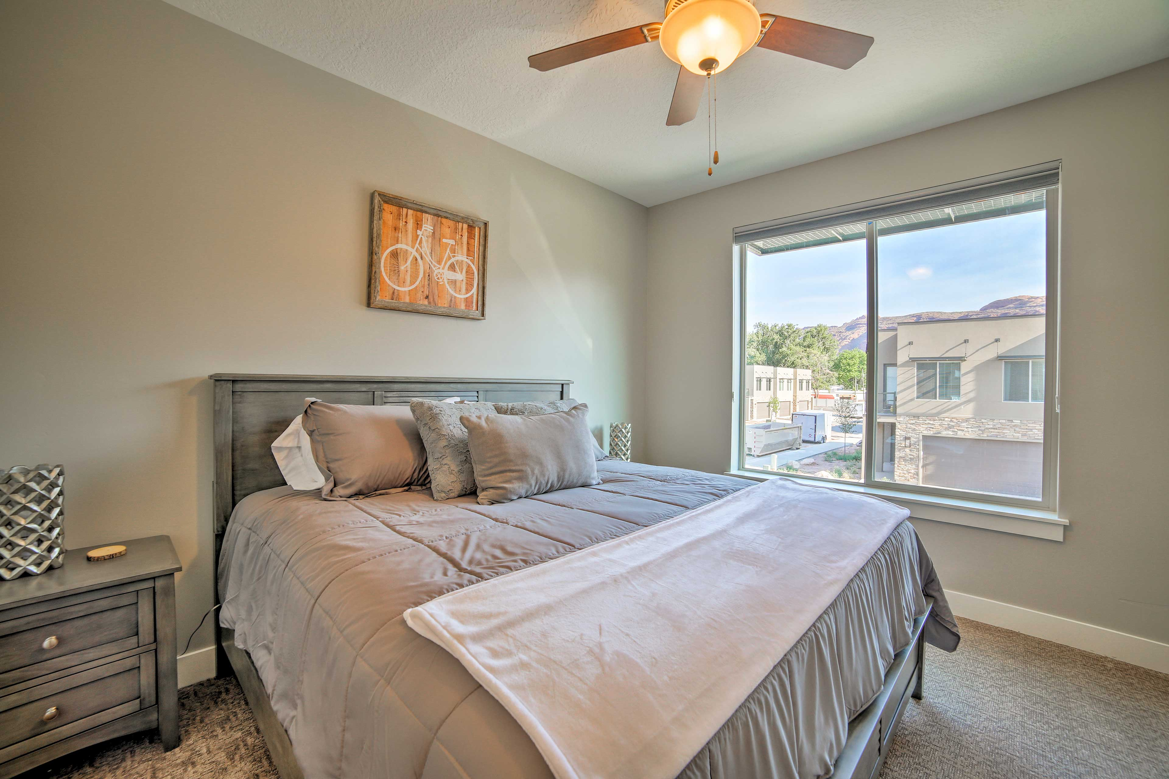 The second master bedroom features a king-sized bed and plenty of storage space.