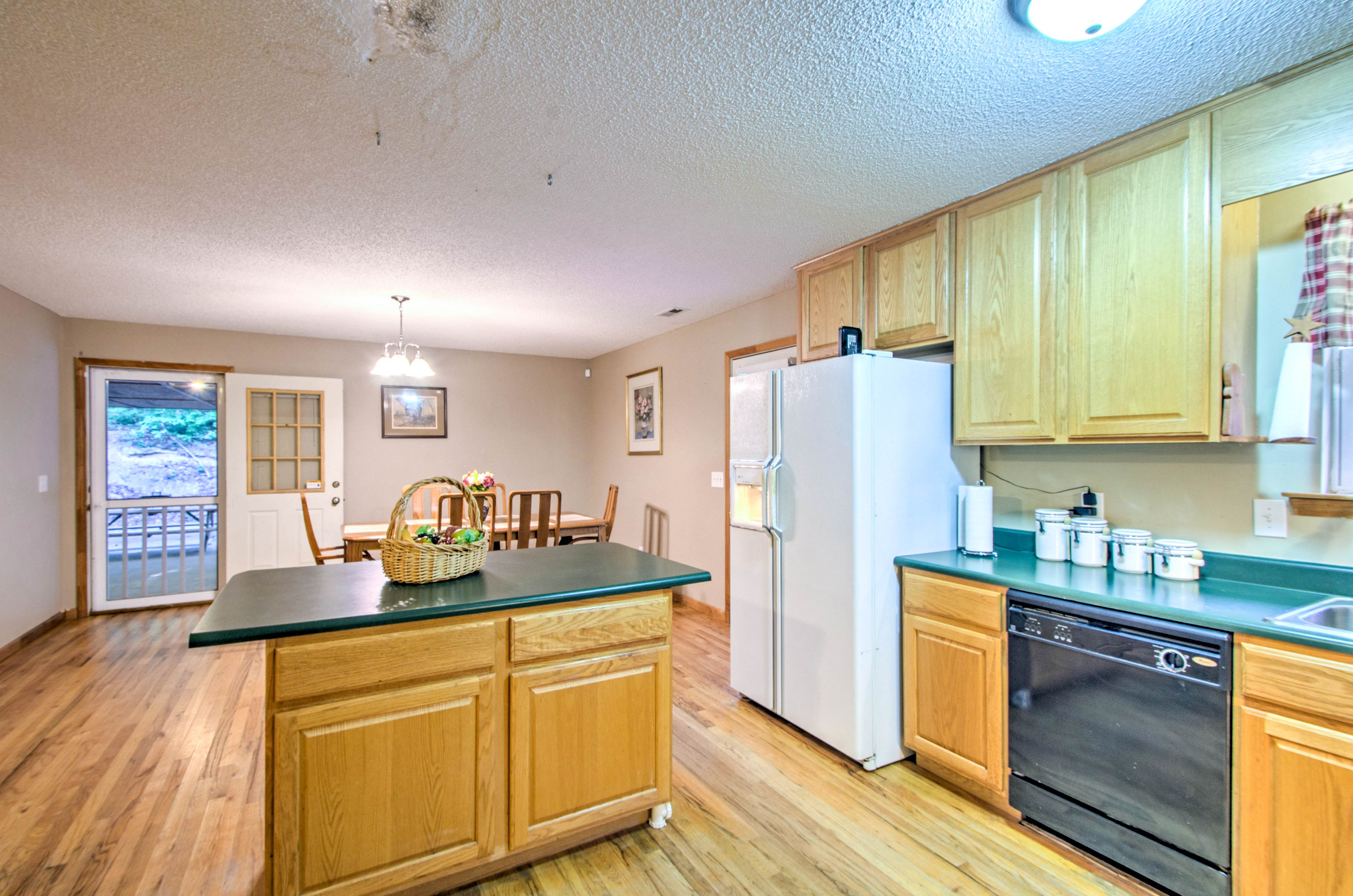 Extended countertops and an island provide plenty of preparation space.
