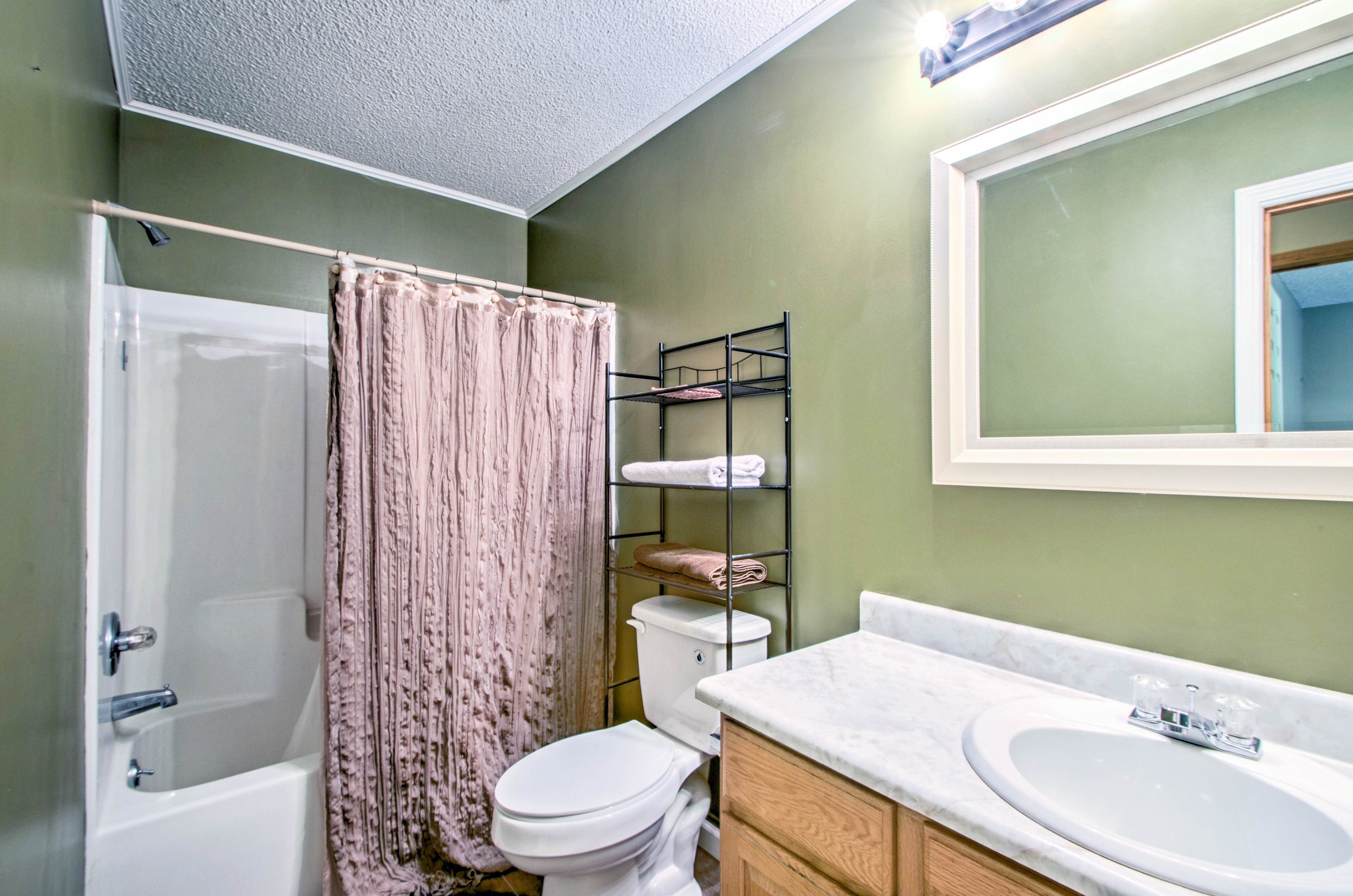Rinse off the dirt after your hikes in the shower/tub combo of this bathroom.