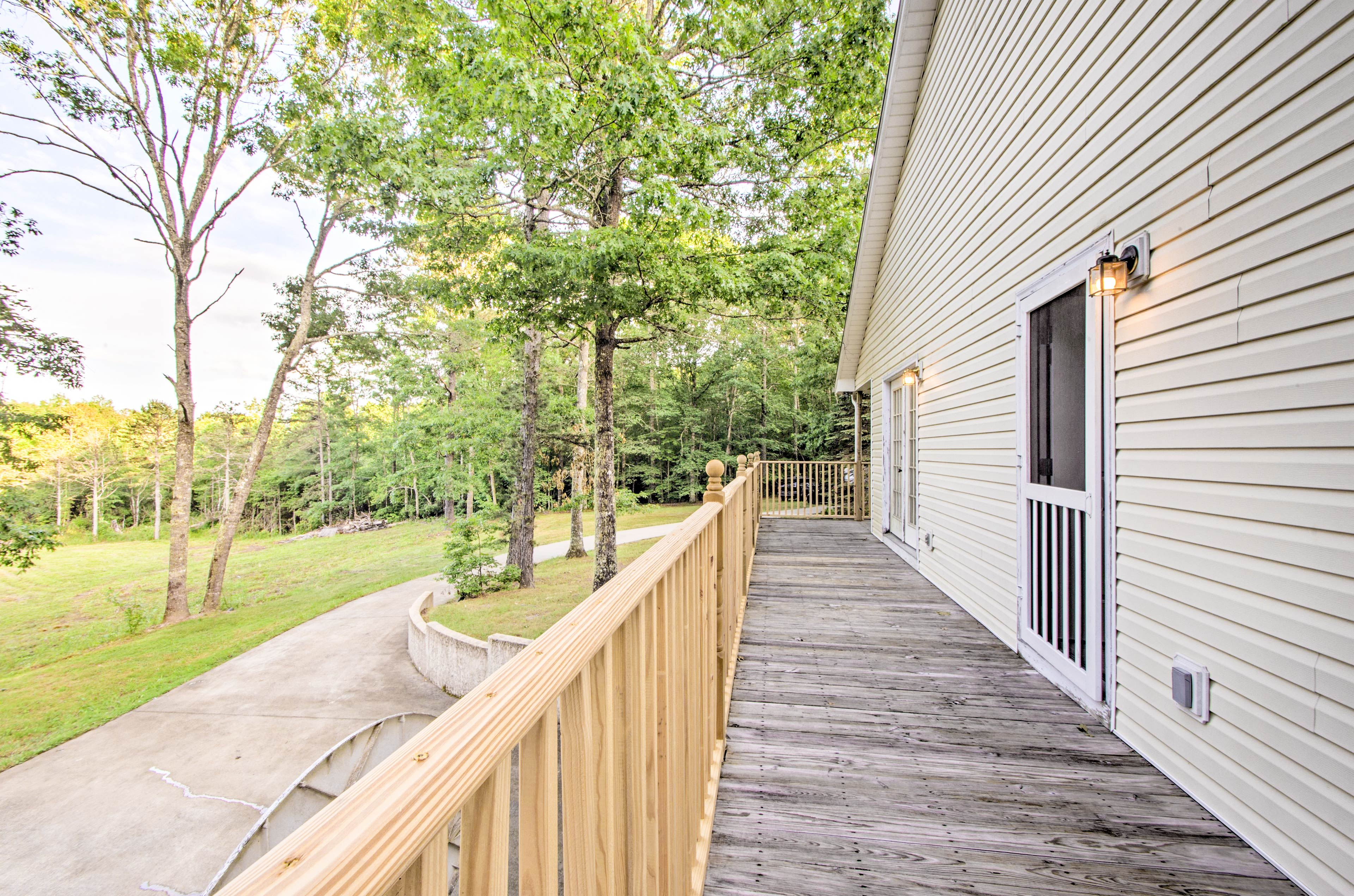 The deck wraps around the side of the house to overlook the rolling hills.