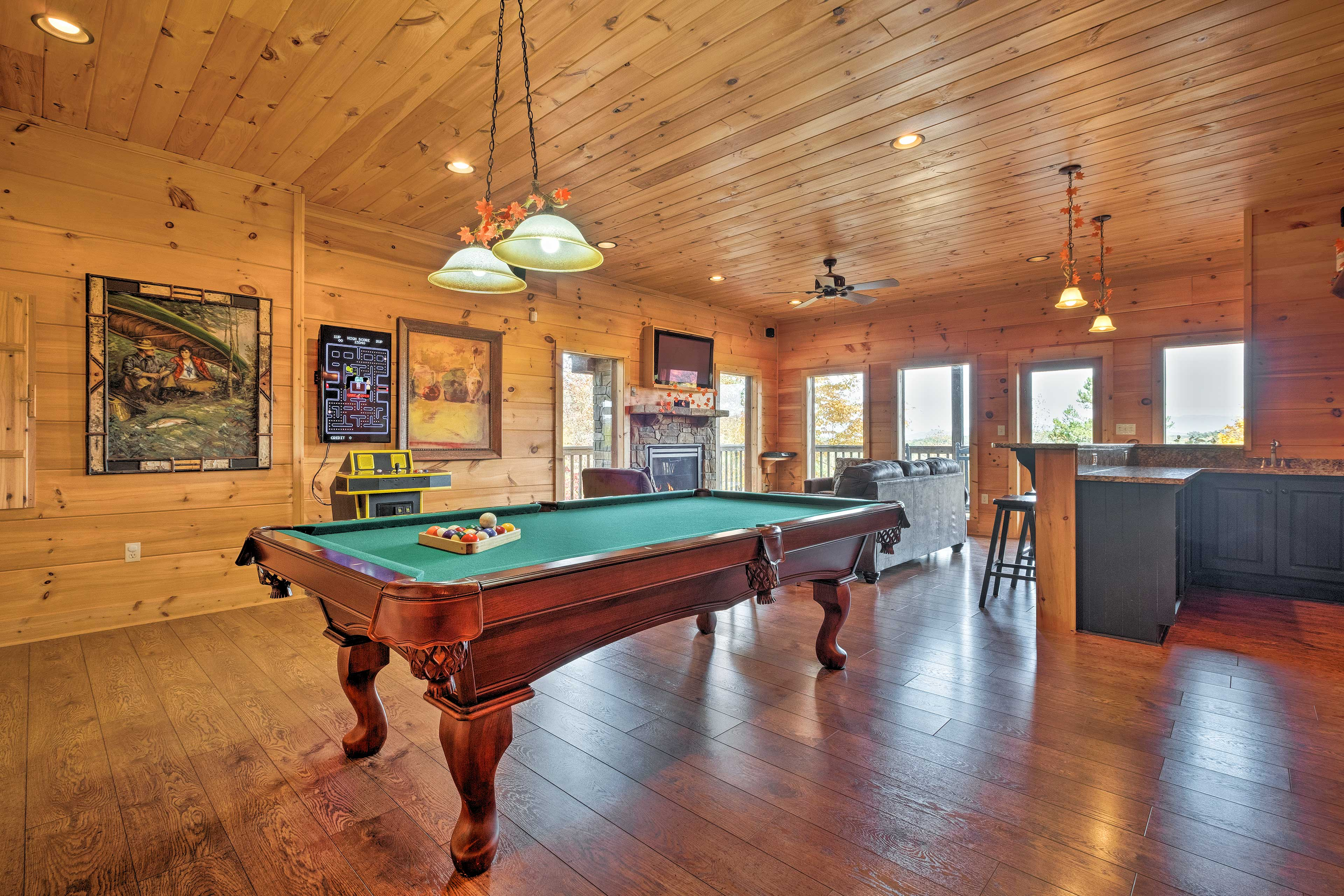 The game room offers a pool table, 60-game multicade arcade, fireplace and TV.