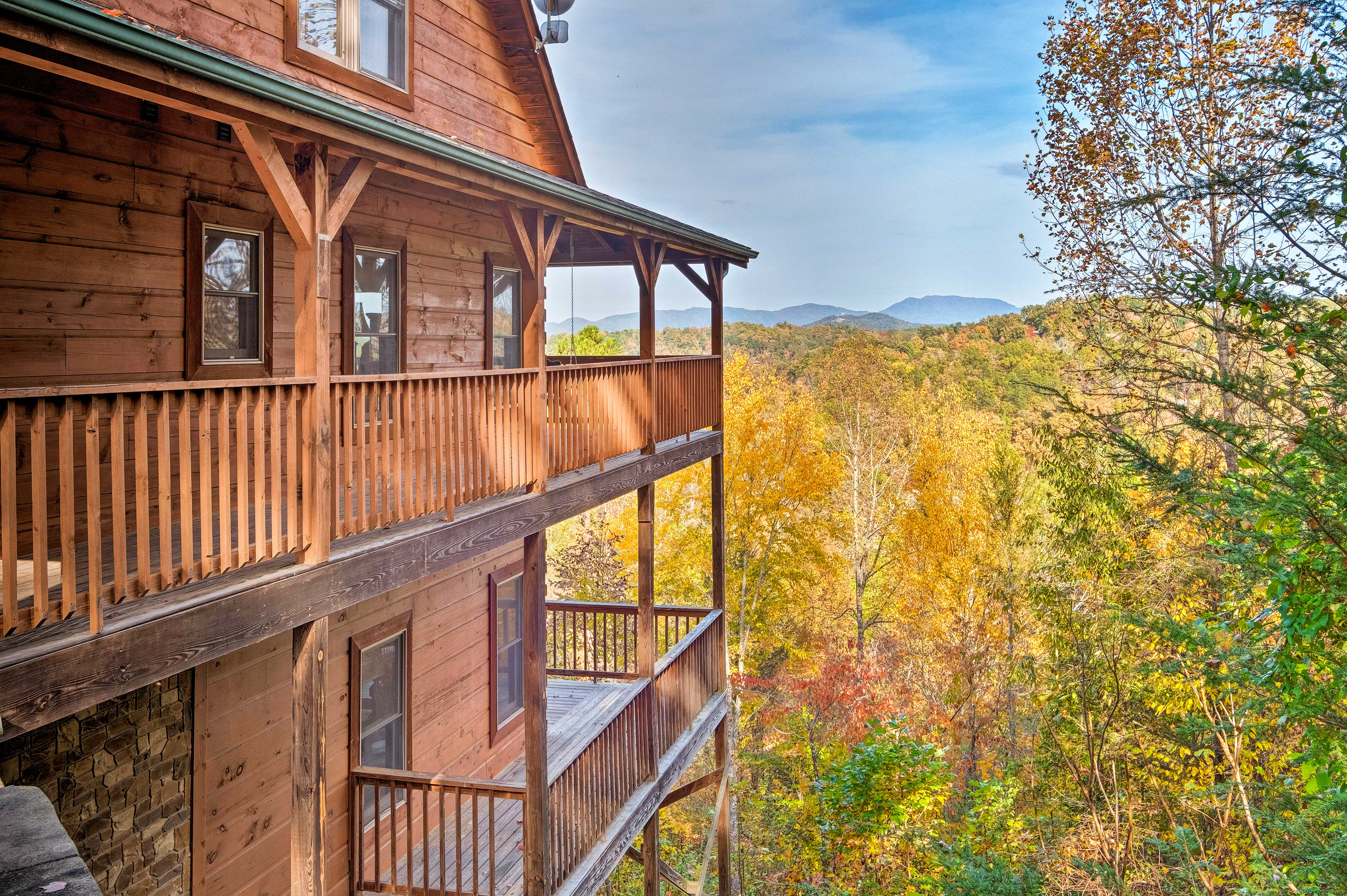 Relish the Smoky Mountain views from the wraparound deck.