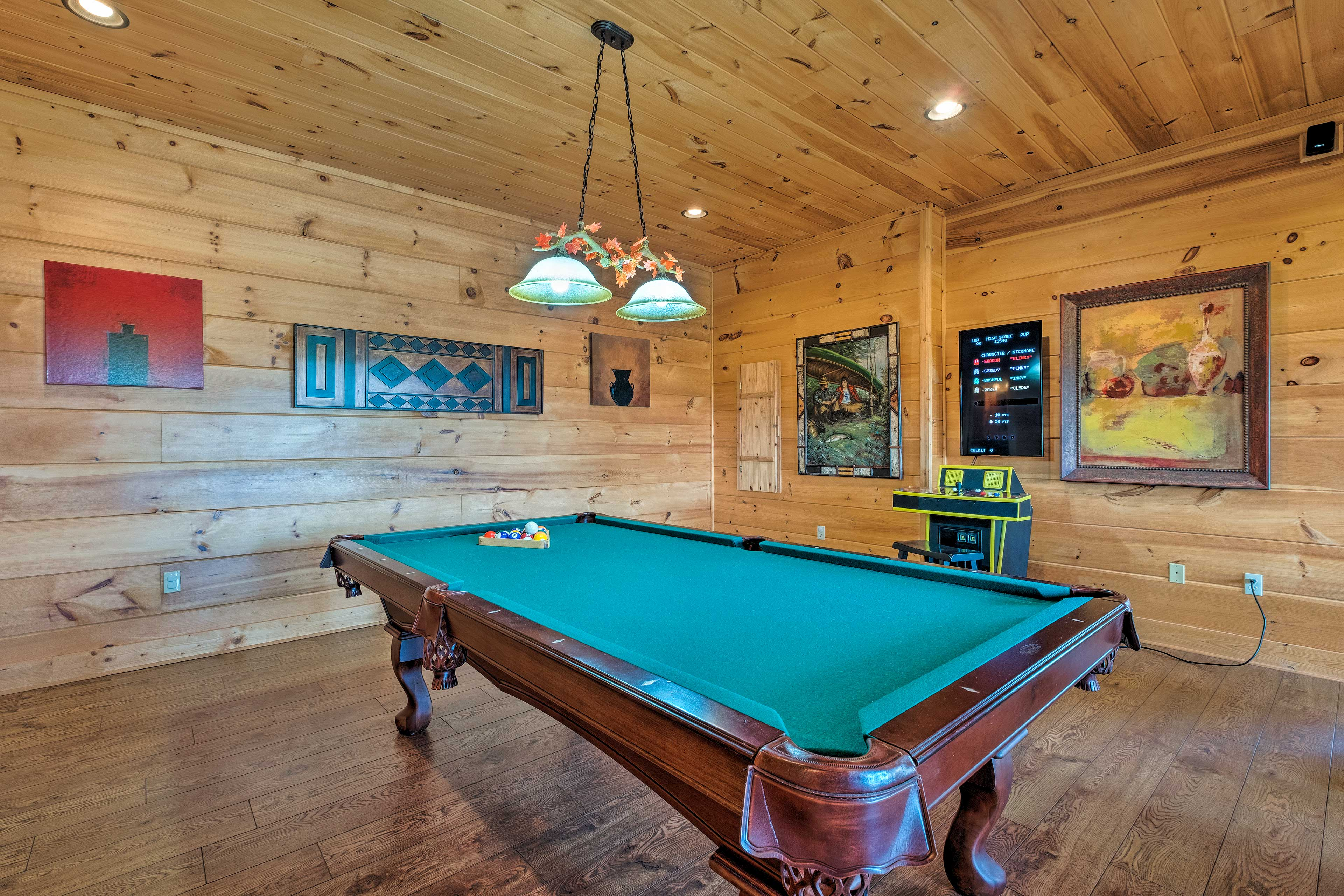 Rack up a game of pool and play 8-ball or cut throat.