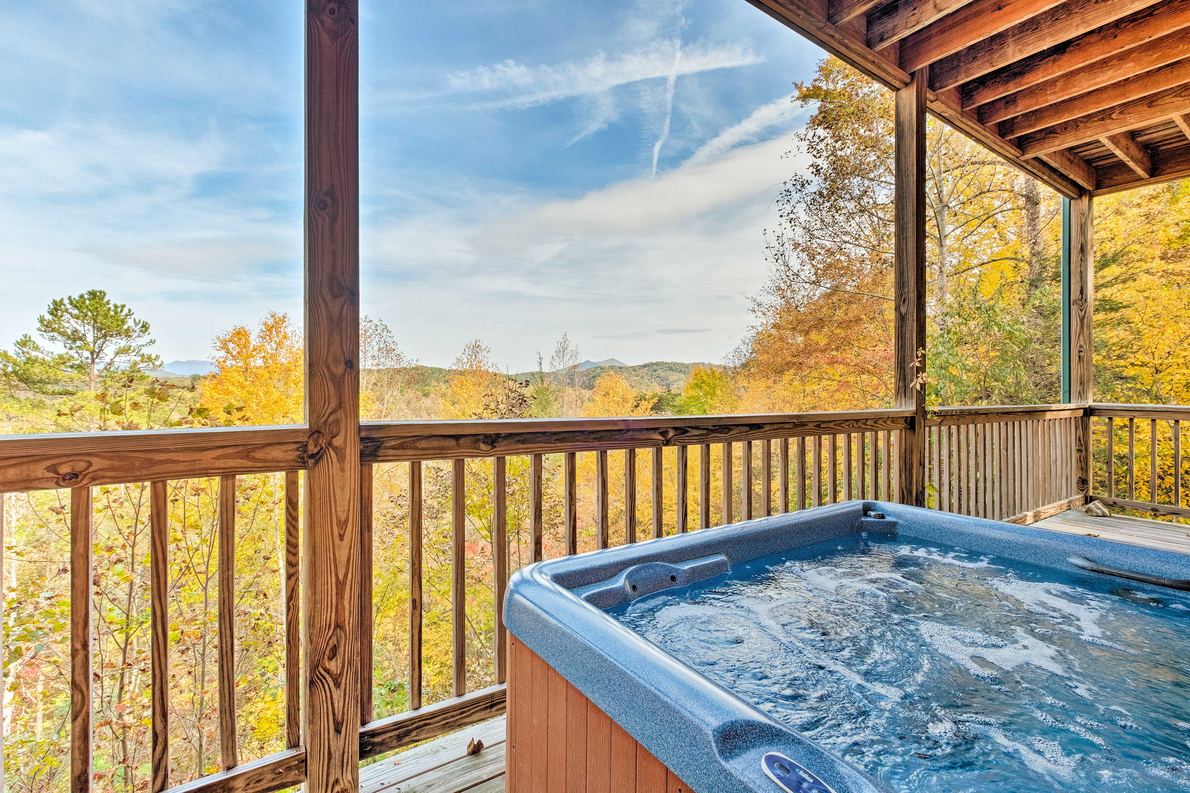 Admire Smoky Mountain views from the soothing hot tub.