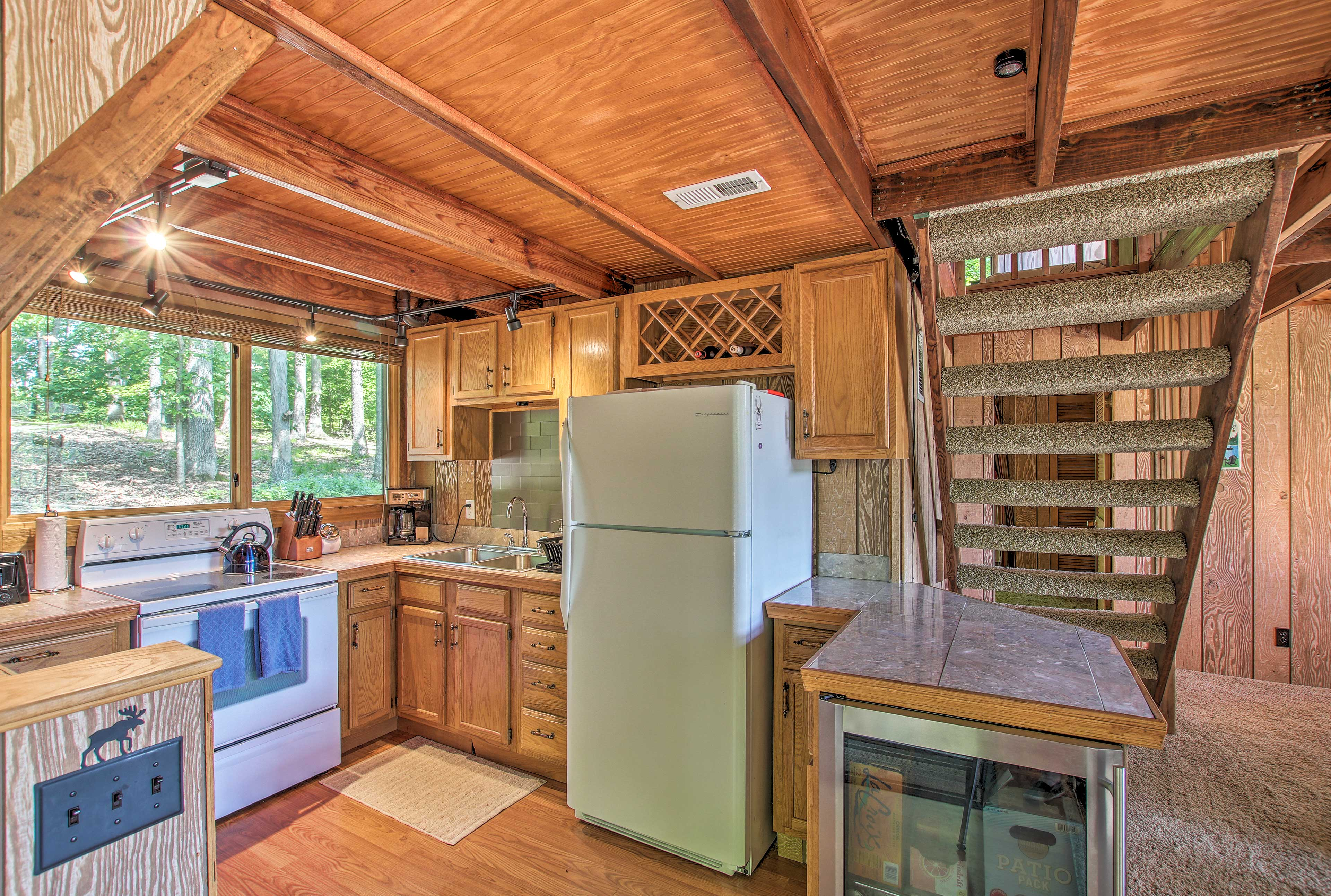 The kitchen is well equipped to handle your cooking needs.
