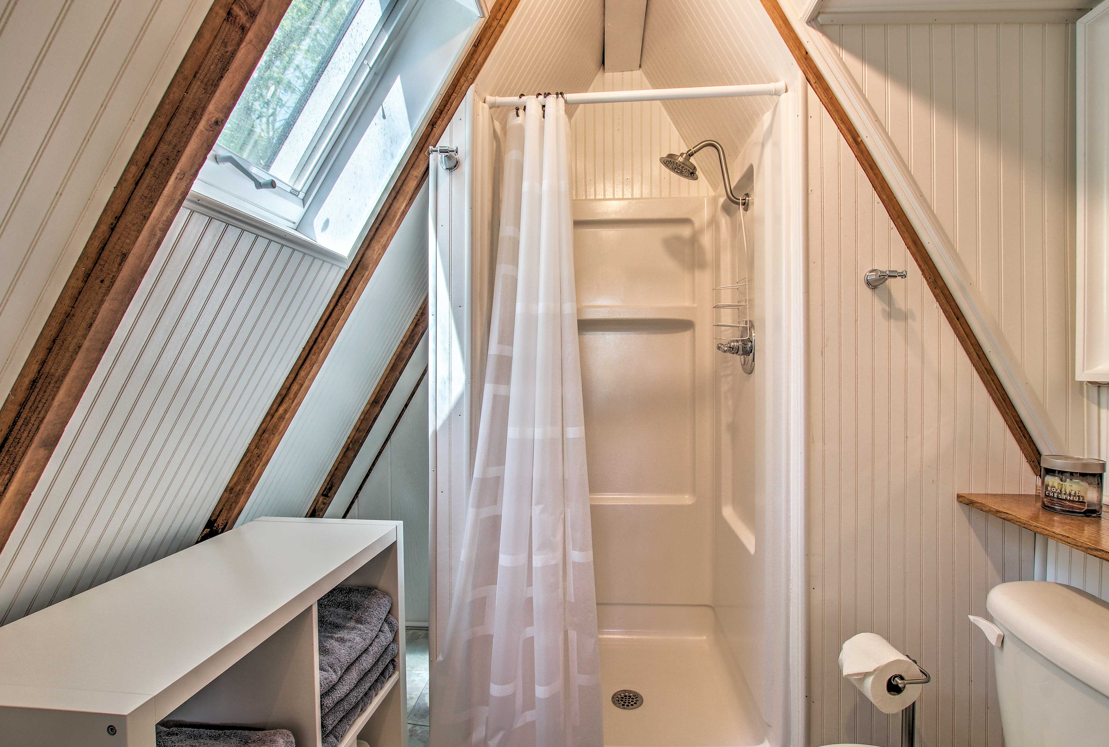 Freshen up and pamper in privacy in this true a-frame bathroom.