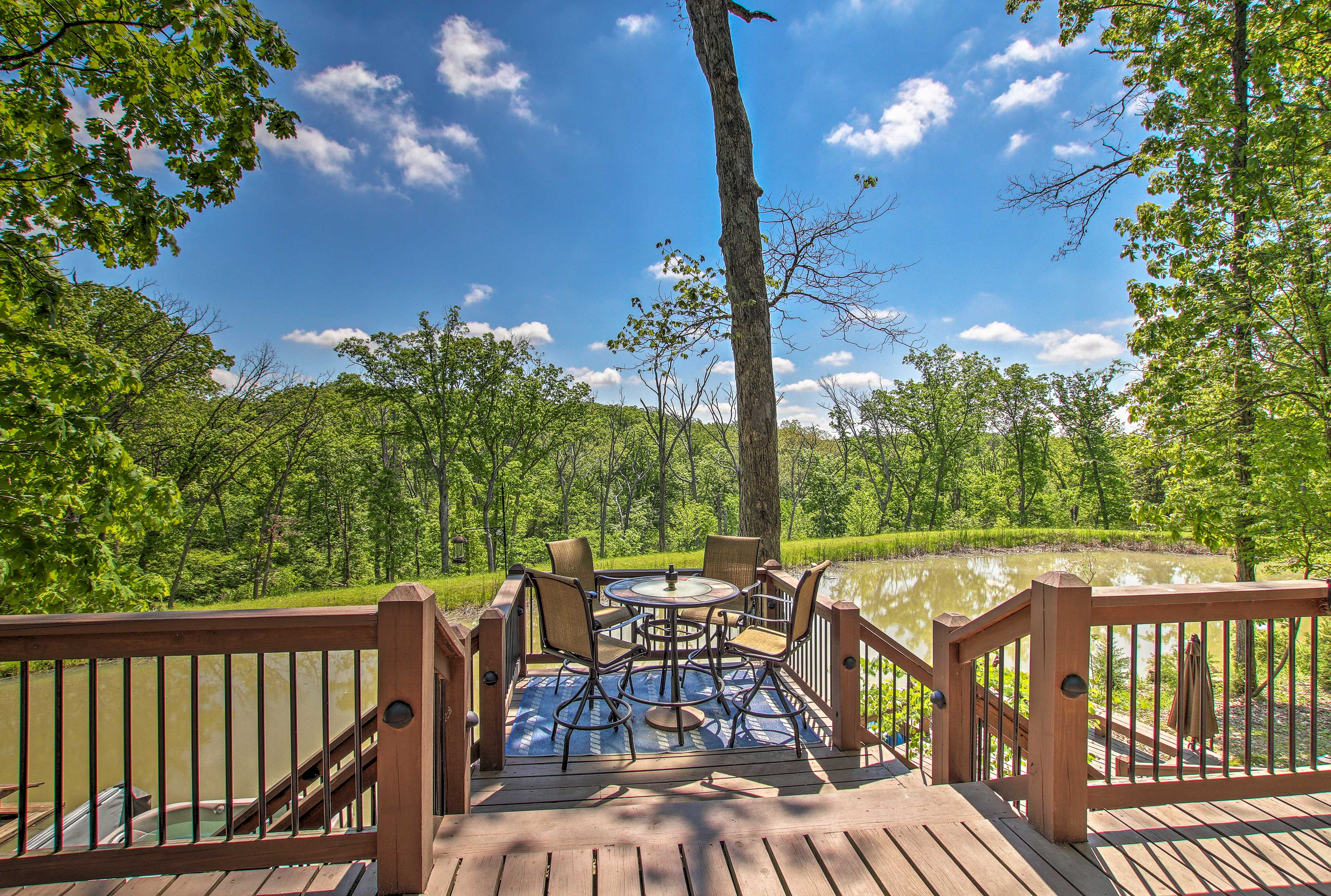This property boasts a private hot tub, fire pit, and ring toss game!