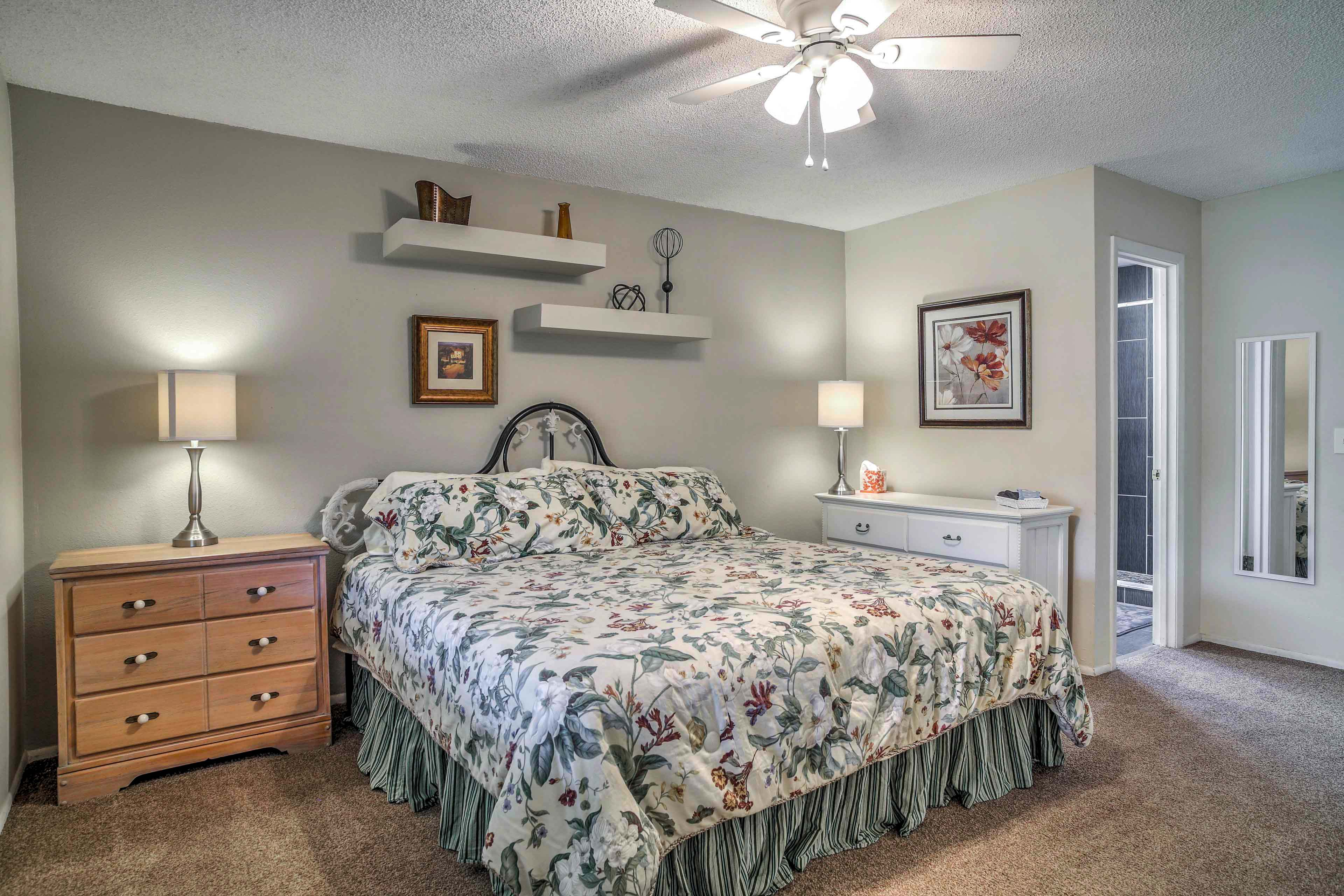 The master bedroom features a cozy king bed and bathroom.
