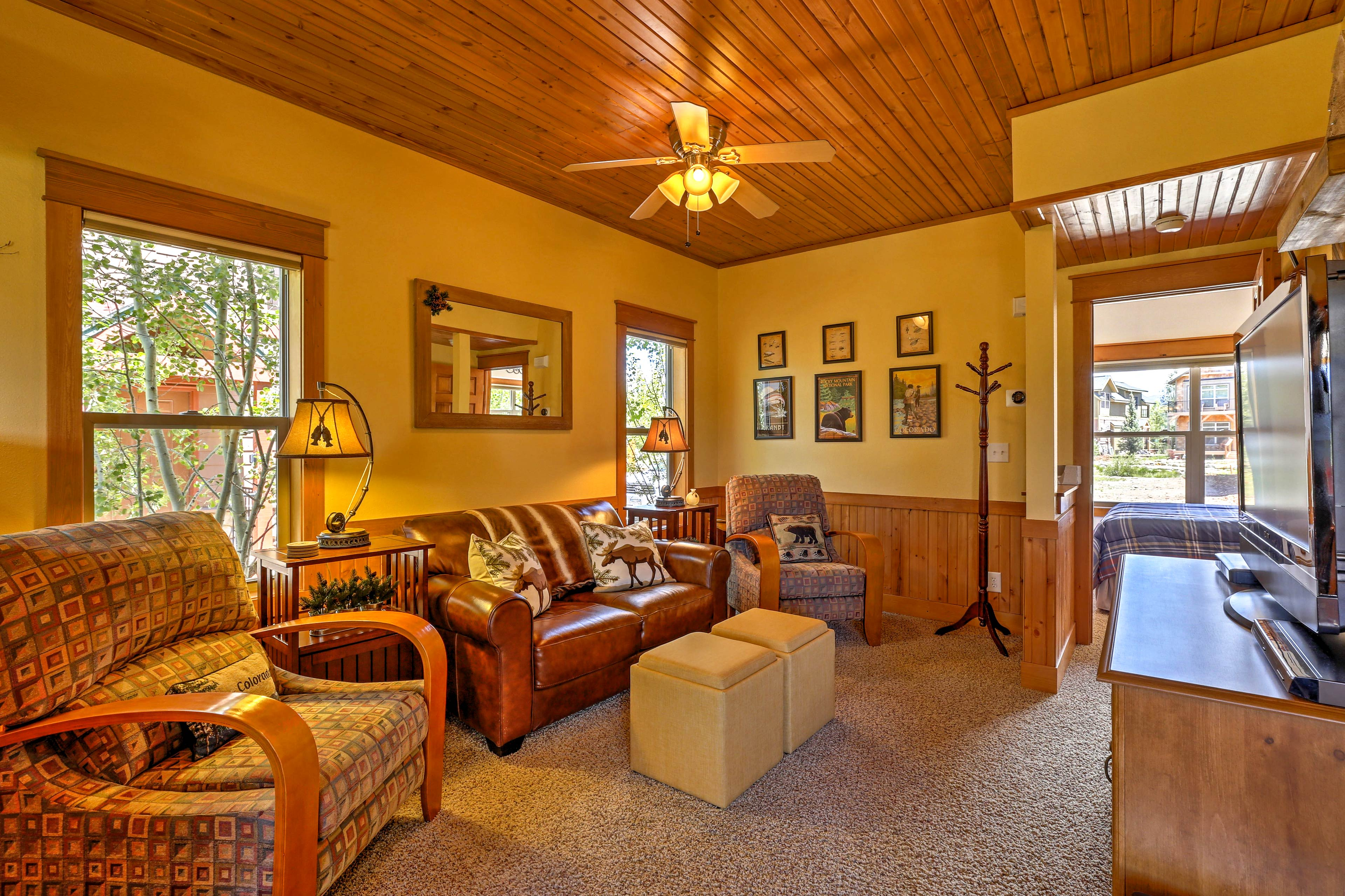 Wood wainscoting and rustic detail create a cozy interior space.
