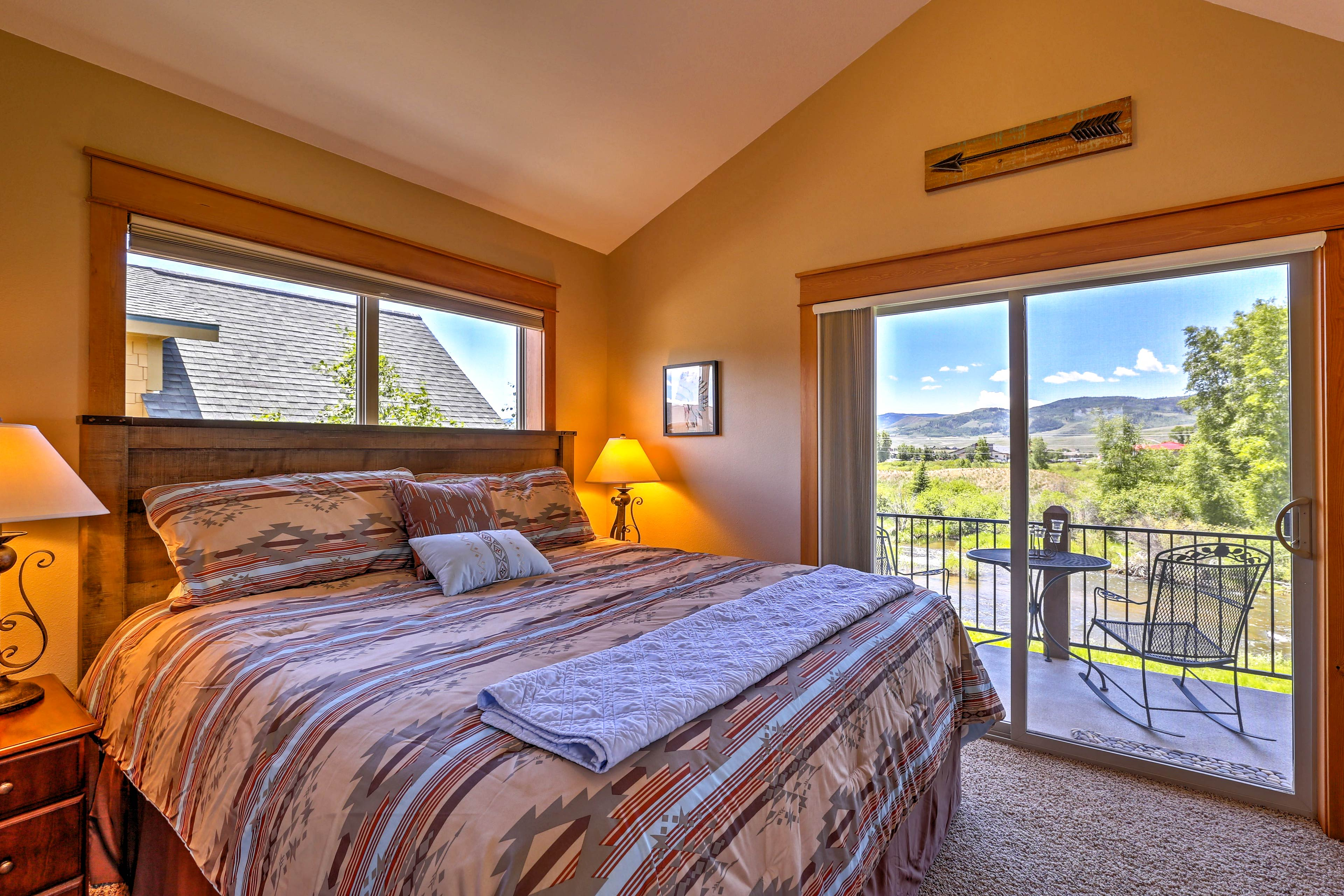 Mountain vistas frame the king bed in the master bedroom.