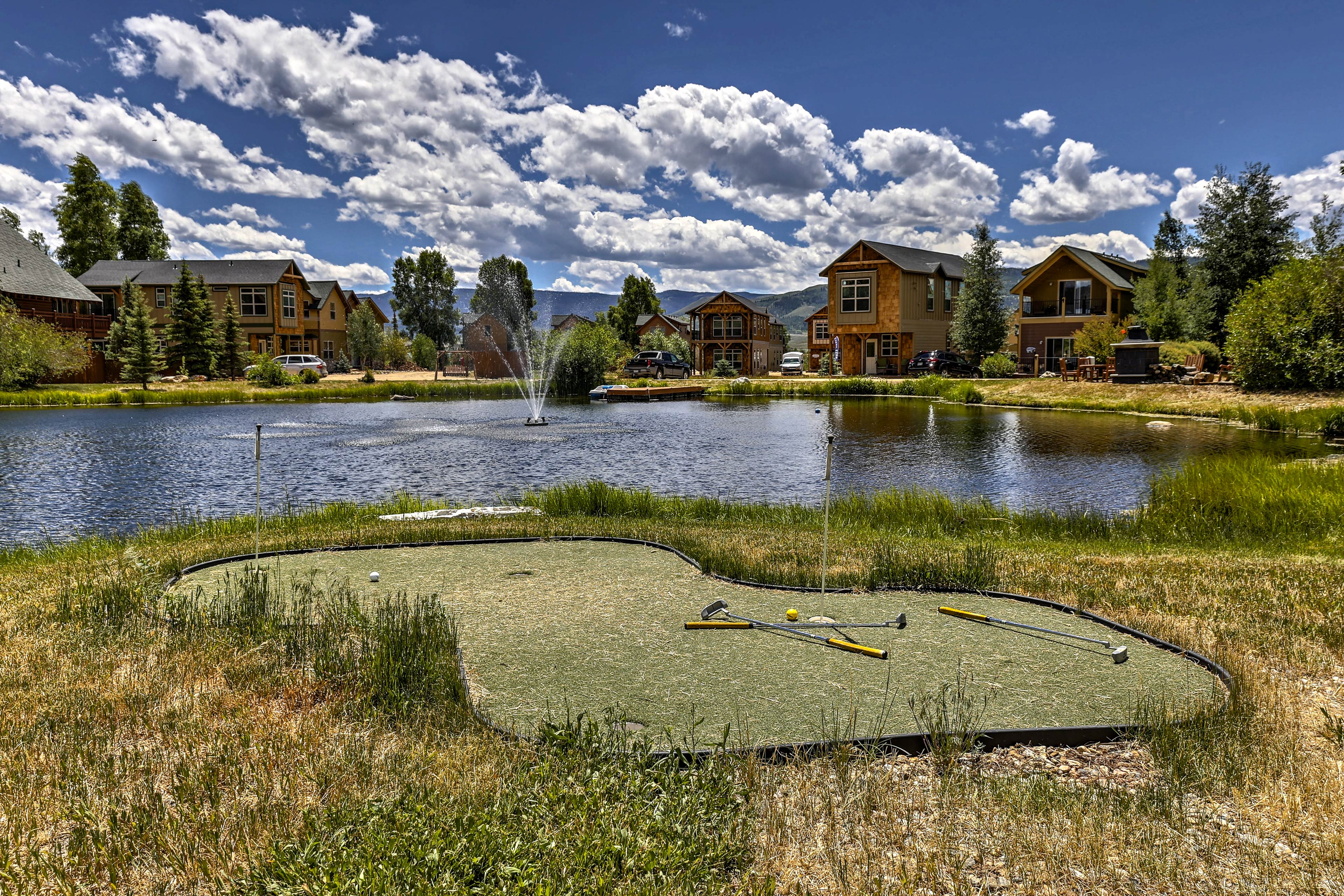 Hone your mini golf skills on the green beside the pond.