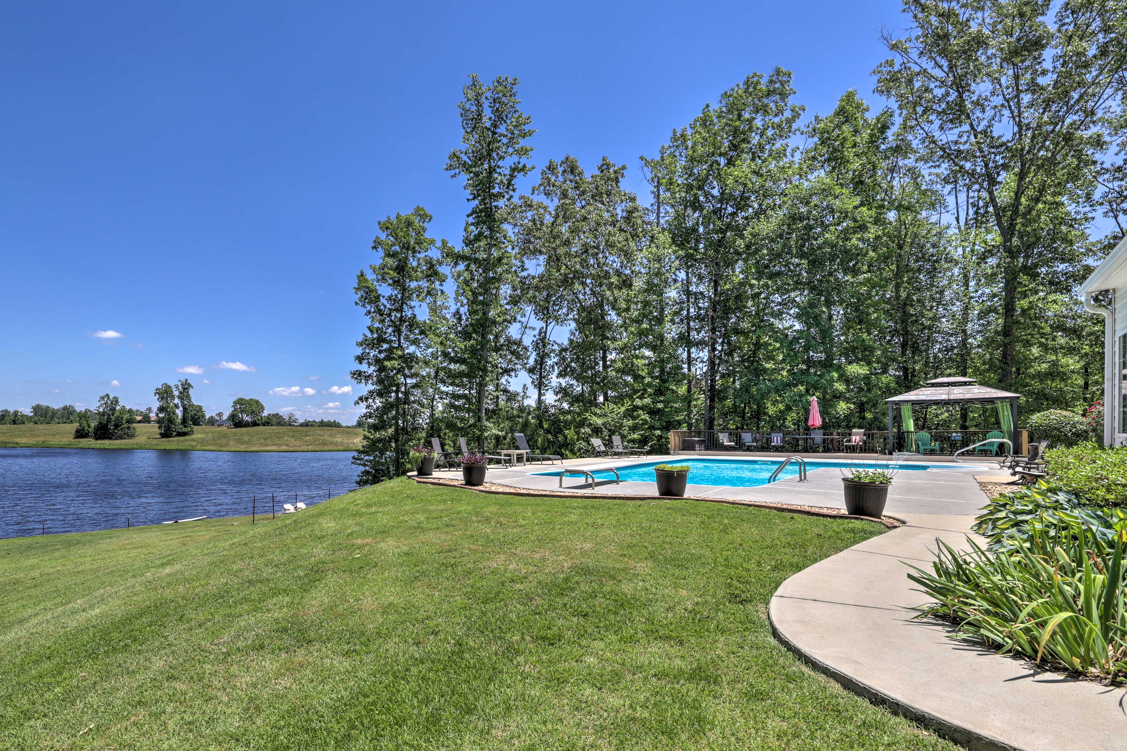 The waterfront property is nestled beside a lake stocked with fish!