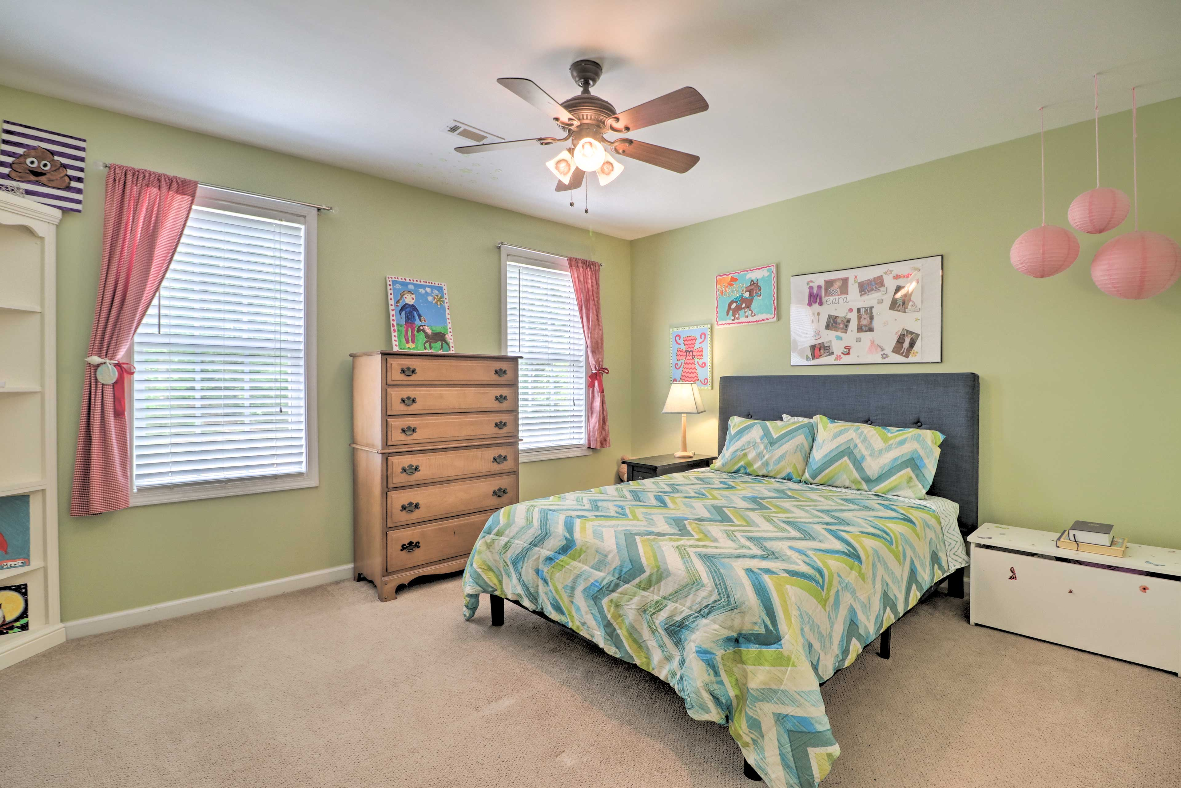 This bright room features a queen-sized bed.
