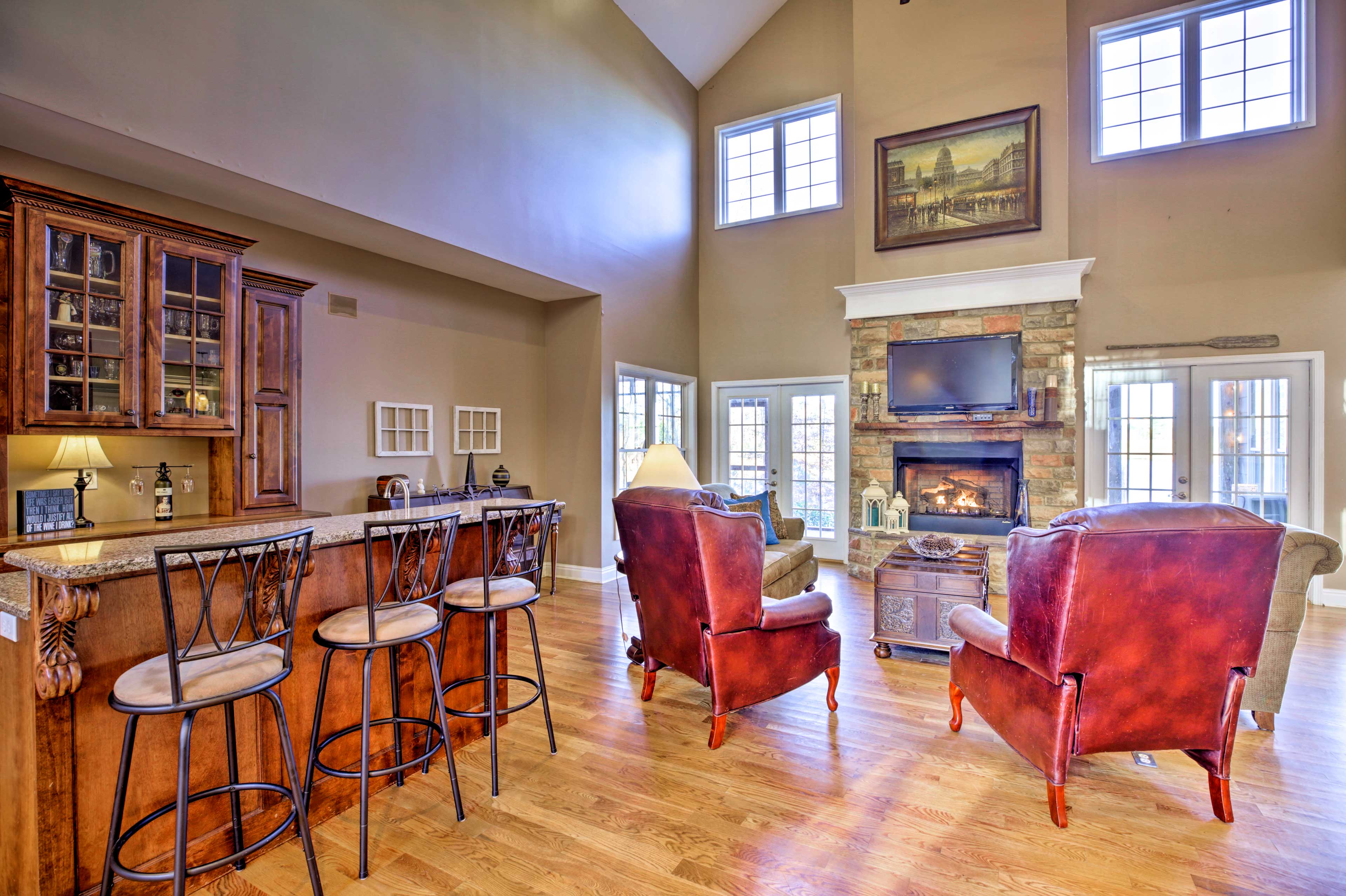 The living area boasts a wet bar, a gas fireplace and a flat-screen TV.
