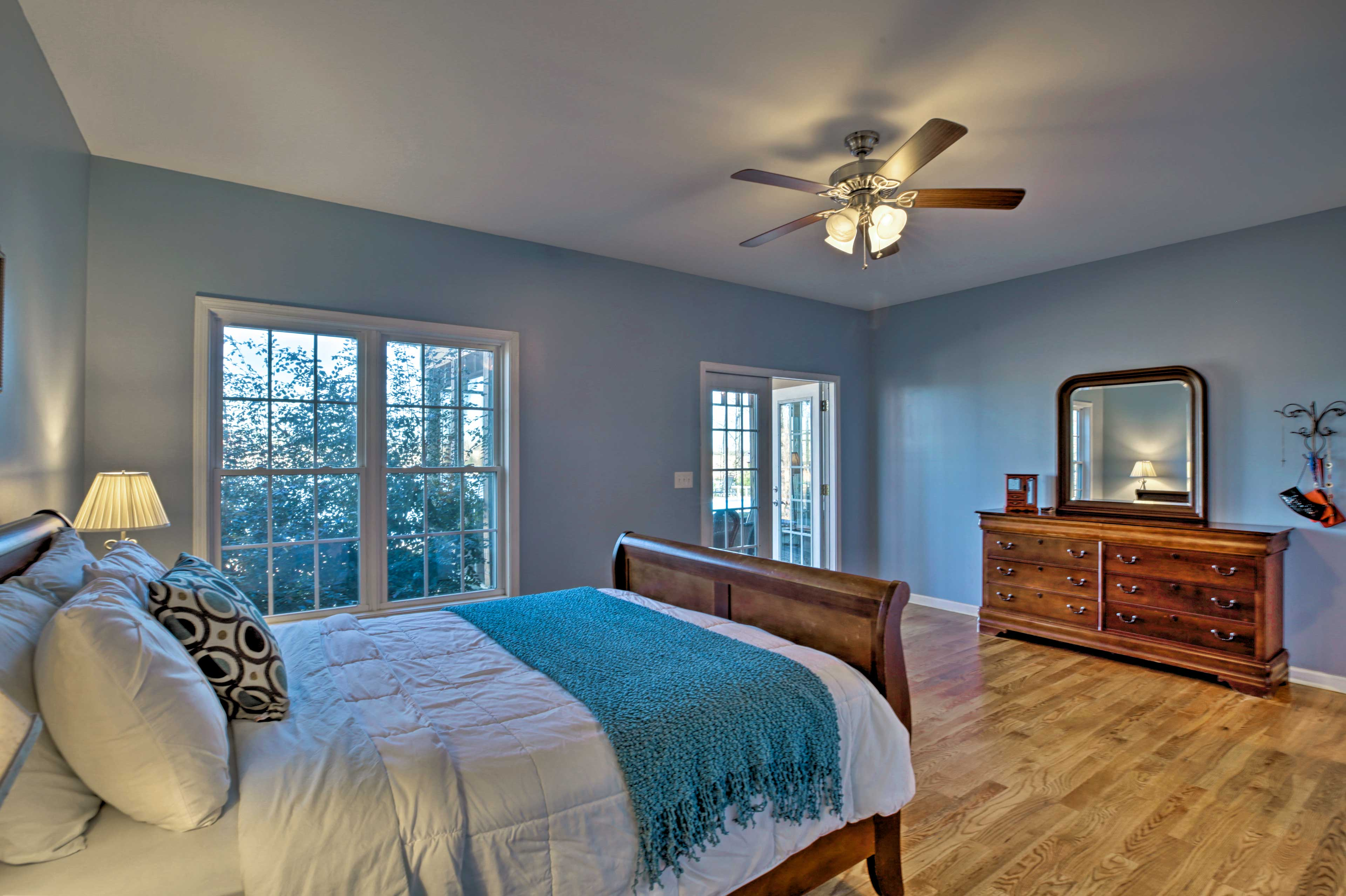 This master bedroom sleeps 2 on a queen bed.