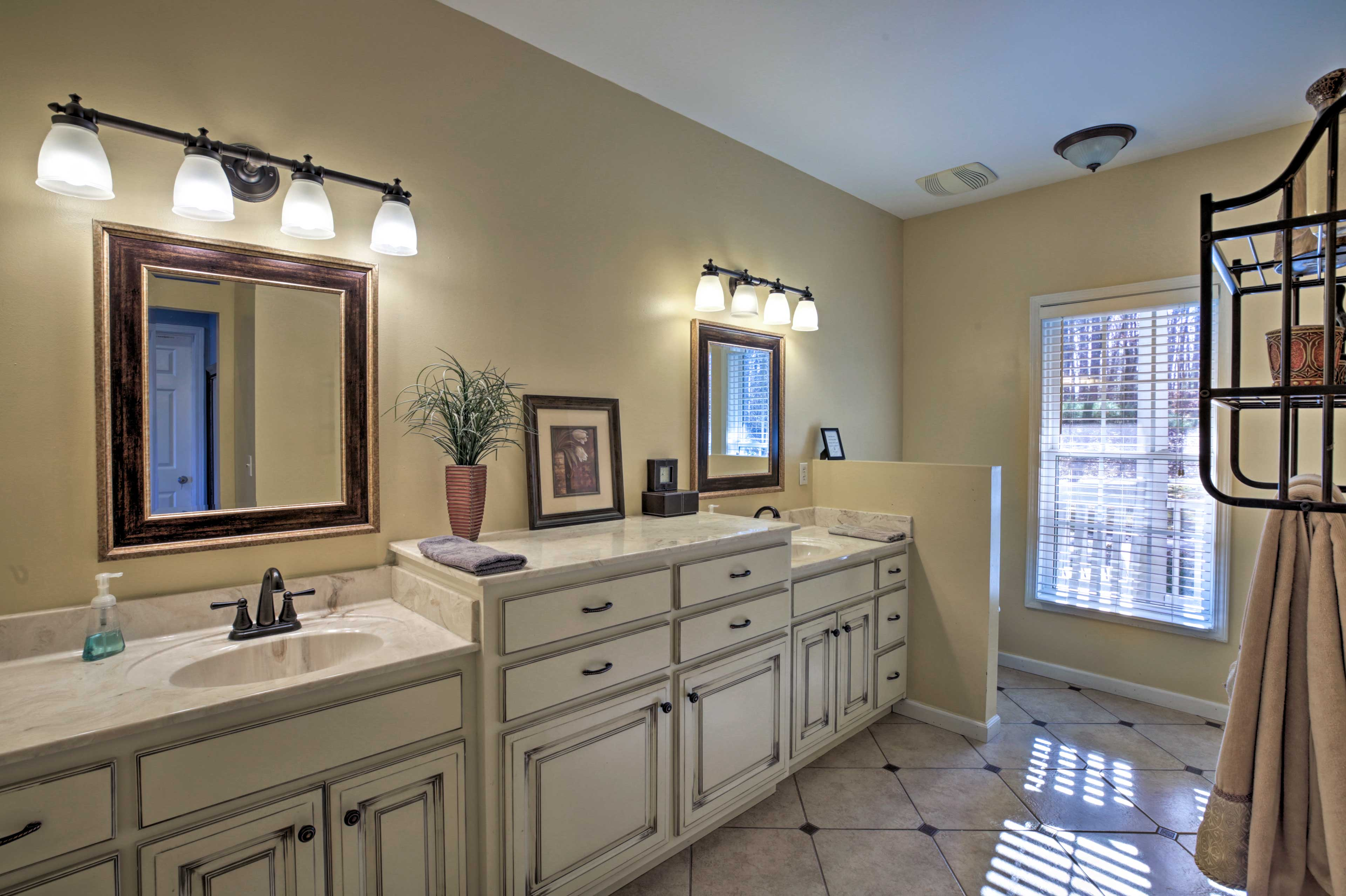 This pristine master bathroom features plenty of counter space.