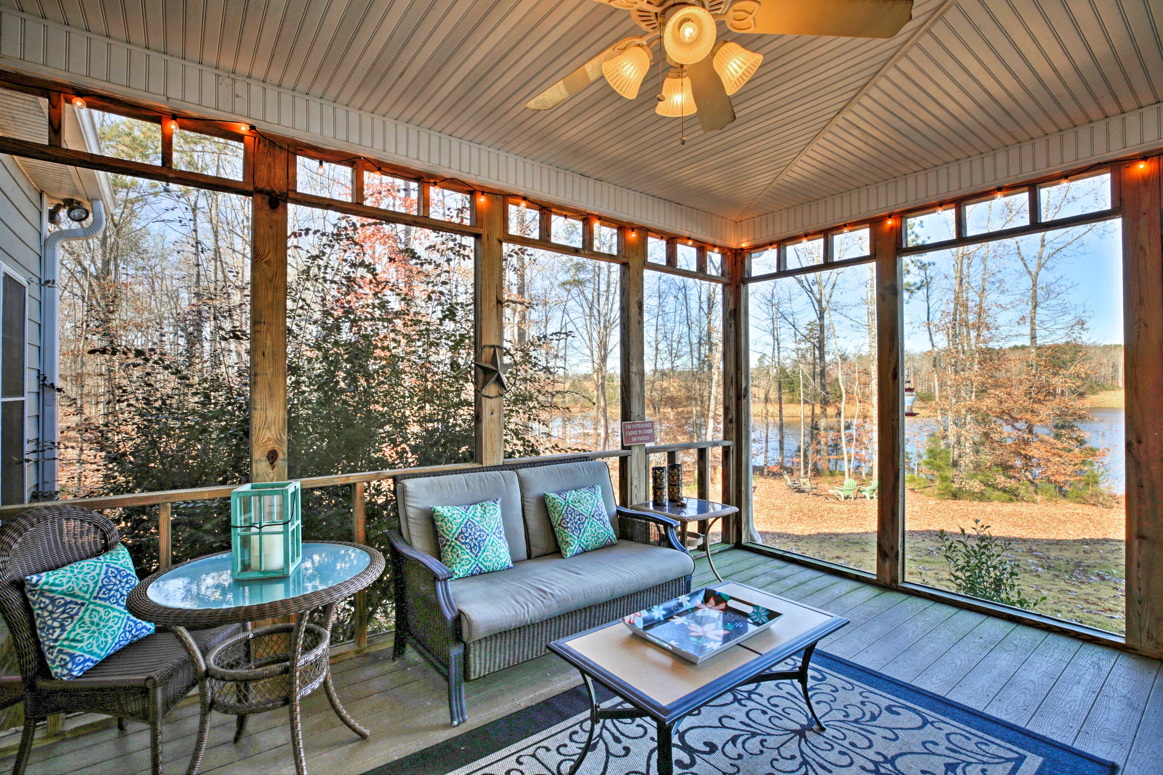 Sink into the comfortable furnishings on the screened-in porch.
