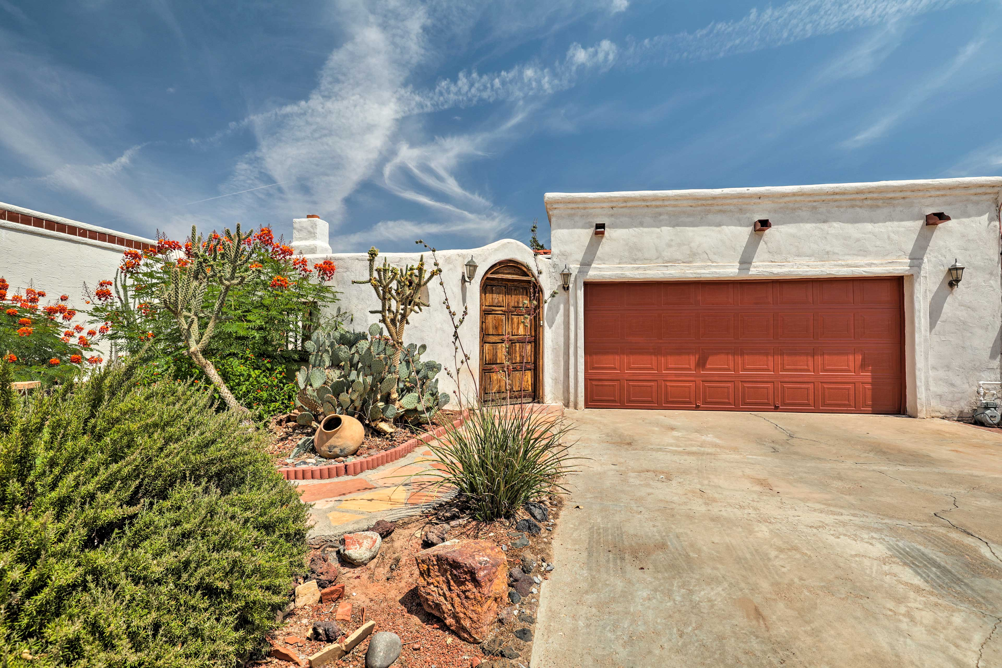 Tranquil desert landscaping surrounds this 3-bedroom home.