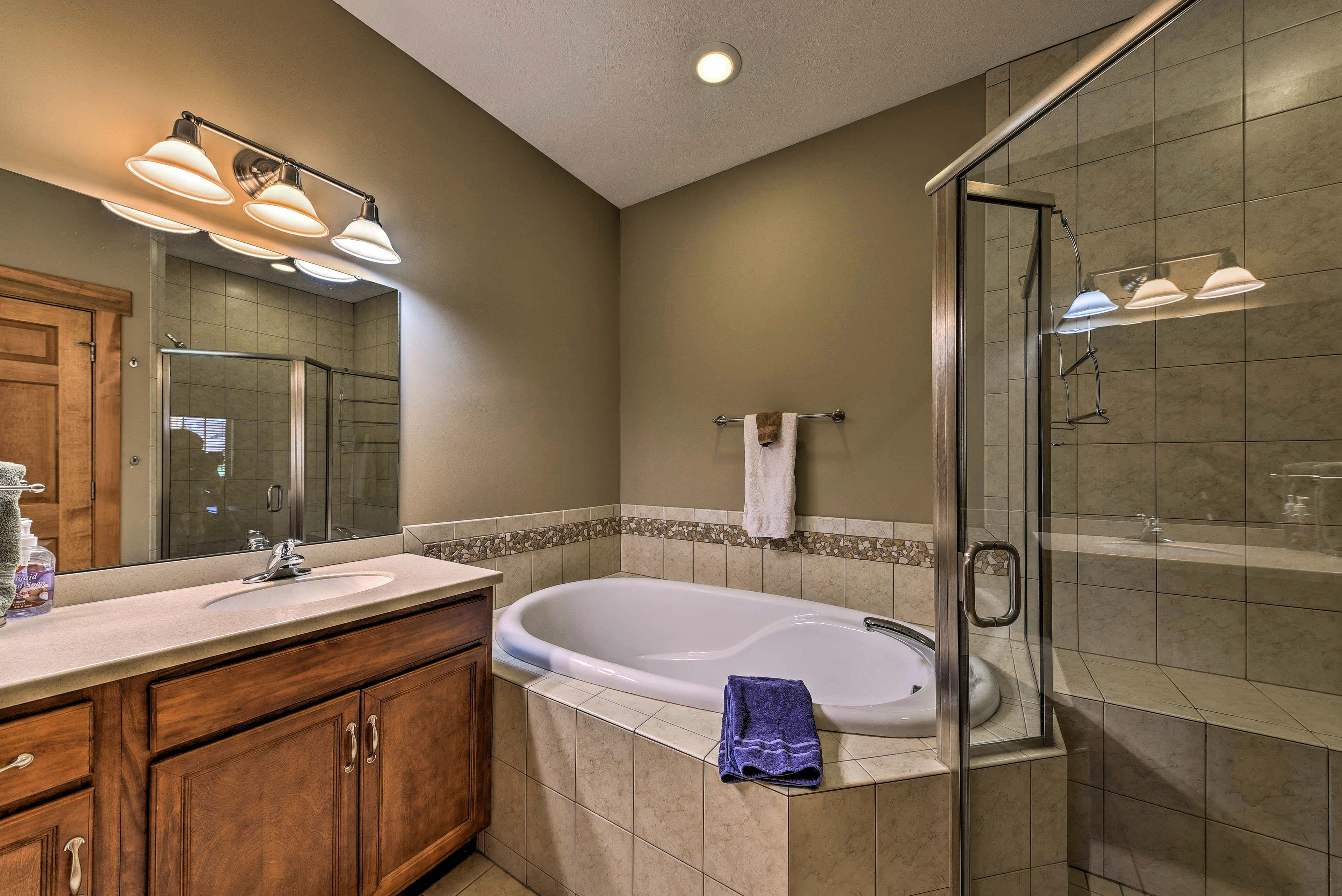 Pour a glass of wine and relax in the jacuzzi tub.