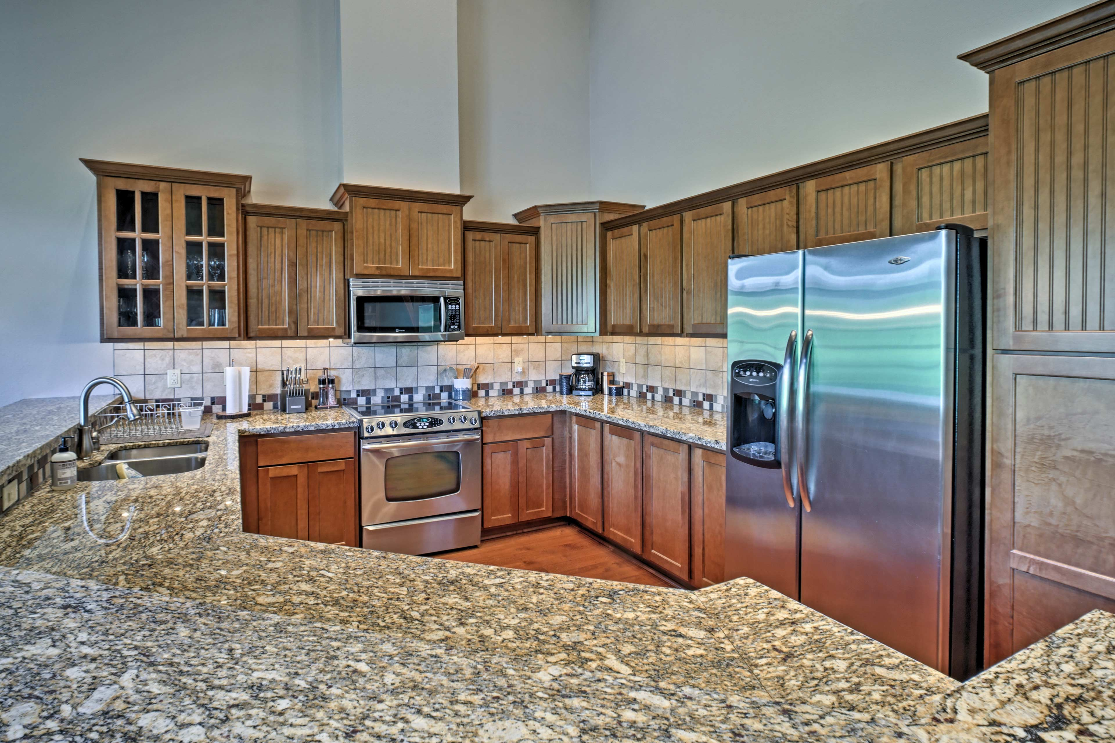 You'll have plenty of space to meal prep atop granite counters!