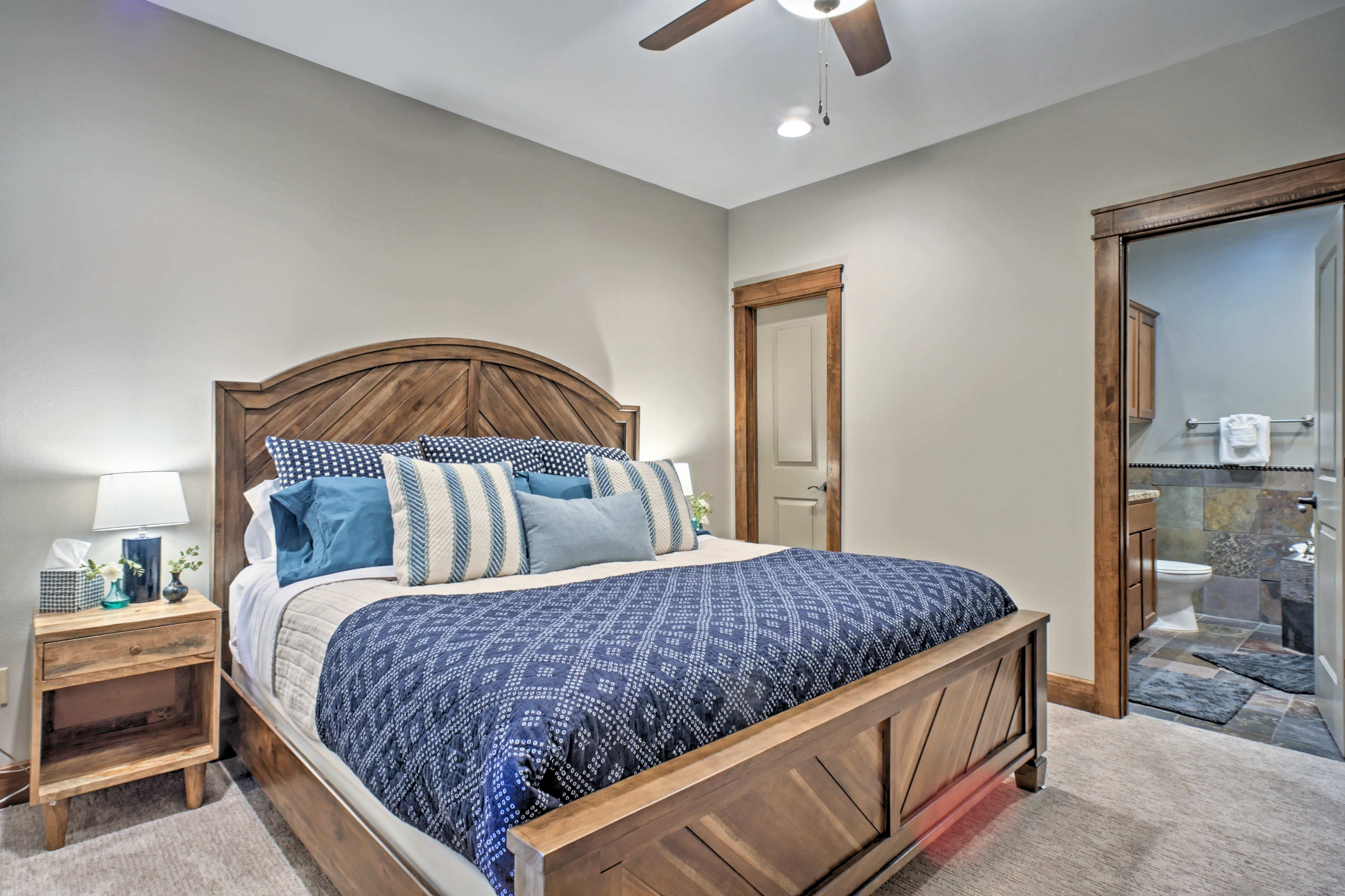 Doze off on the king bed in the master bedroom.