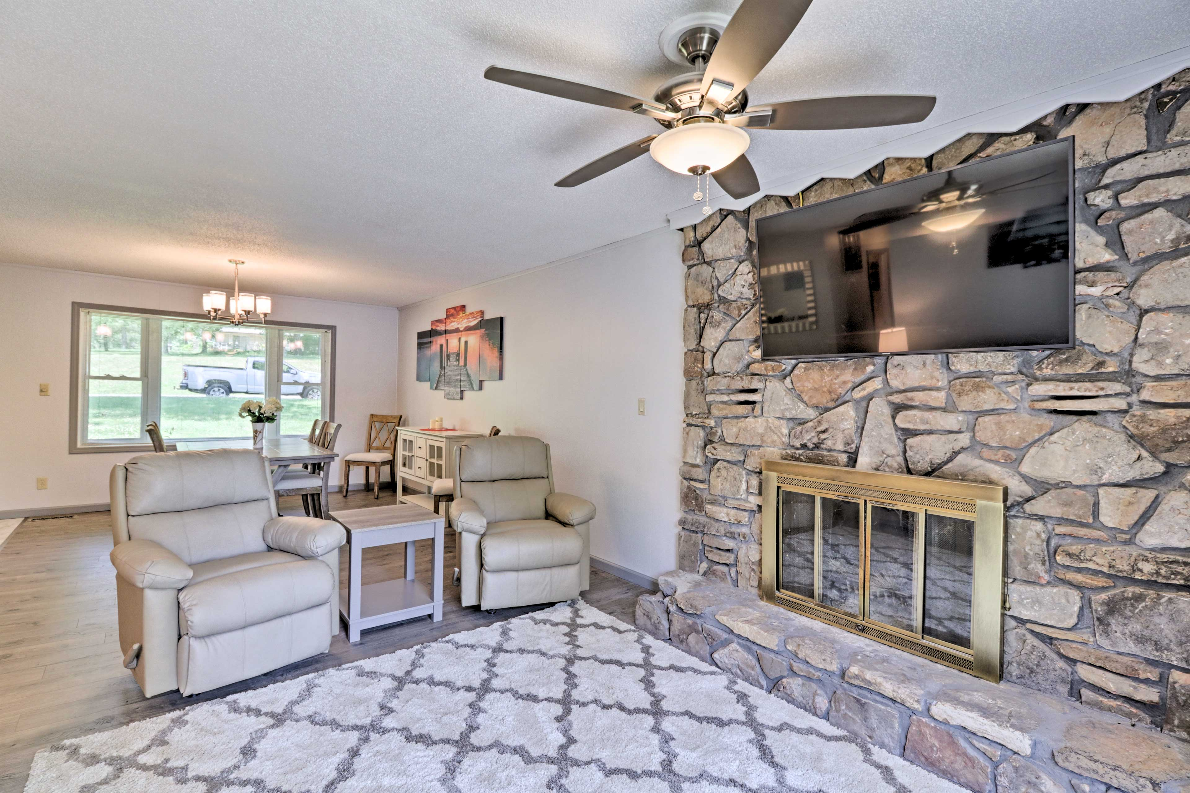 The decorative fireplace adds a lovely ambiance to the space.