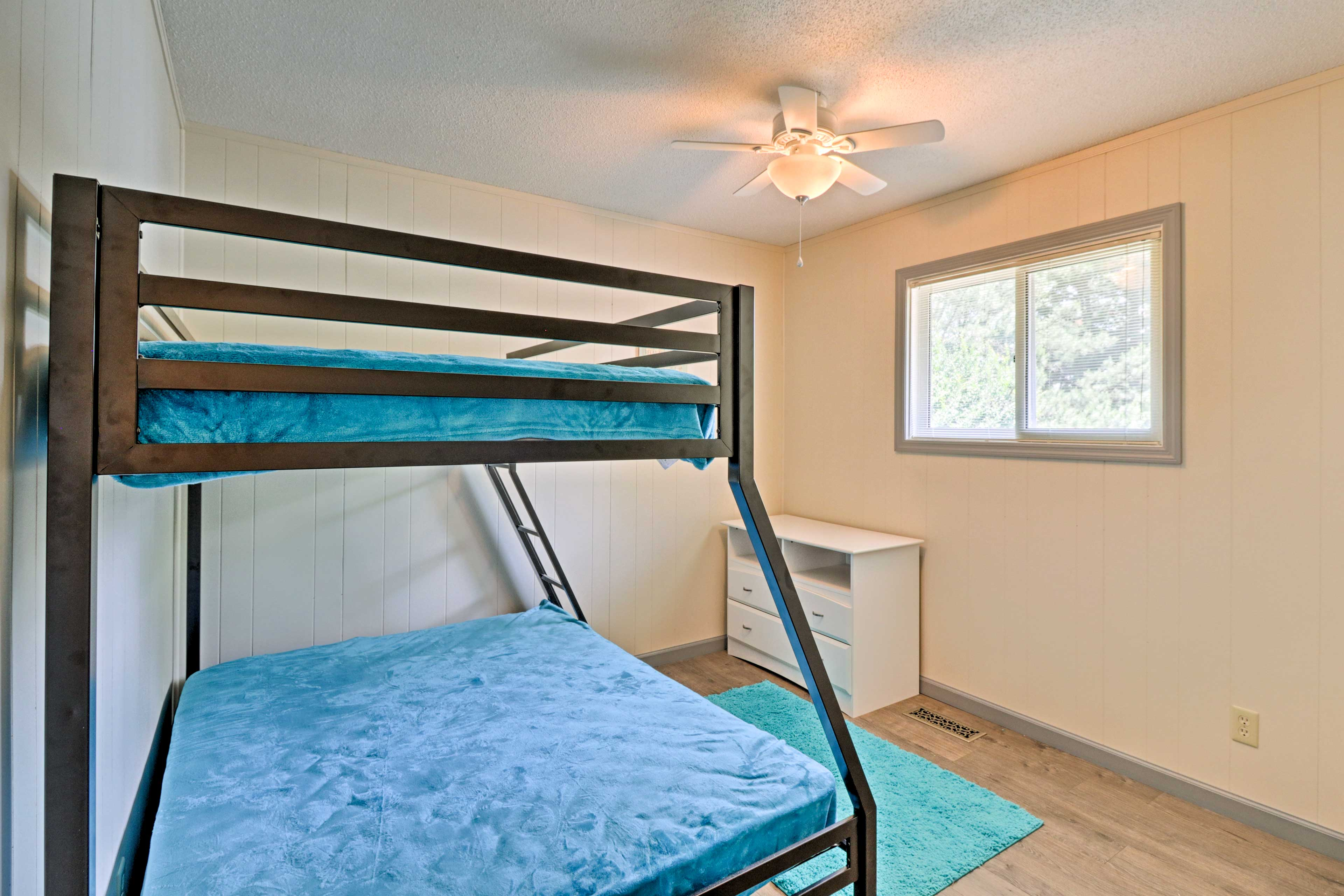The kids will love a space all their own in the second room.