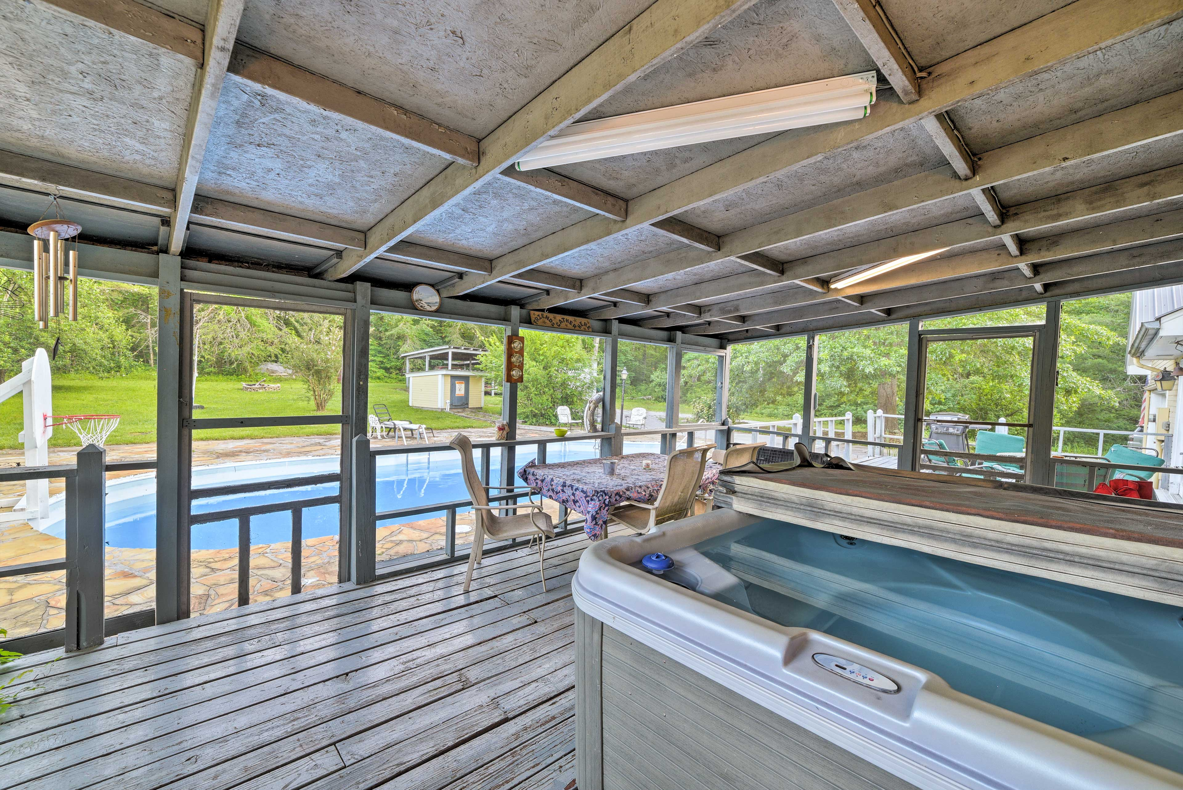 Take a relaxing dip in the private hot tub with your loved ones.