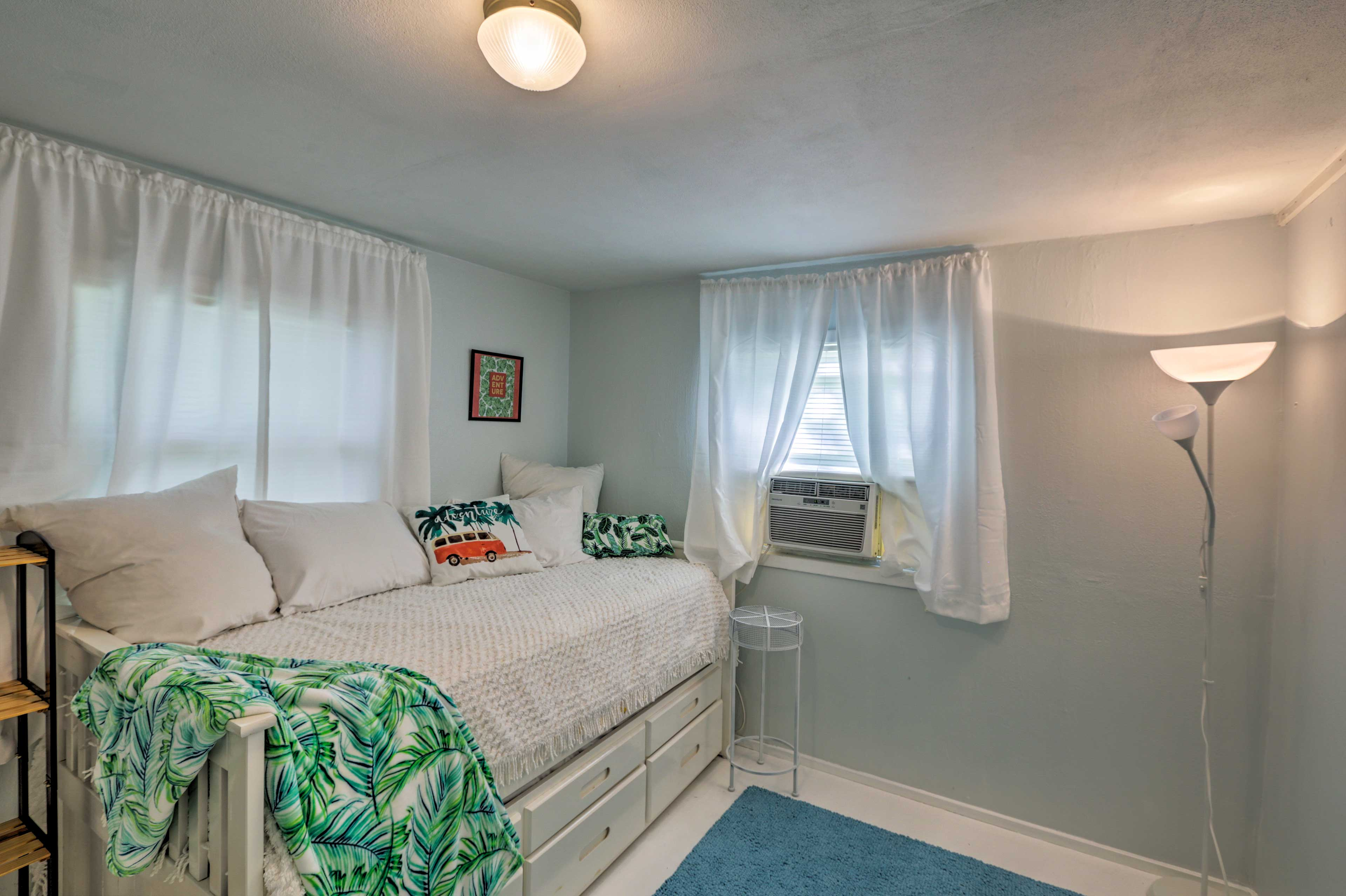 This bedroom offers a twin bed and twin trundle bed.