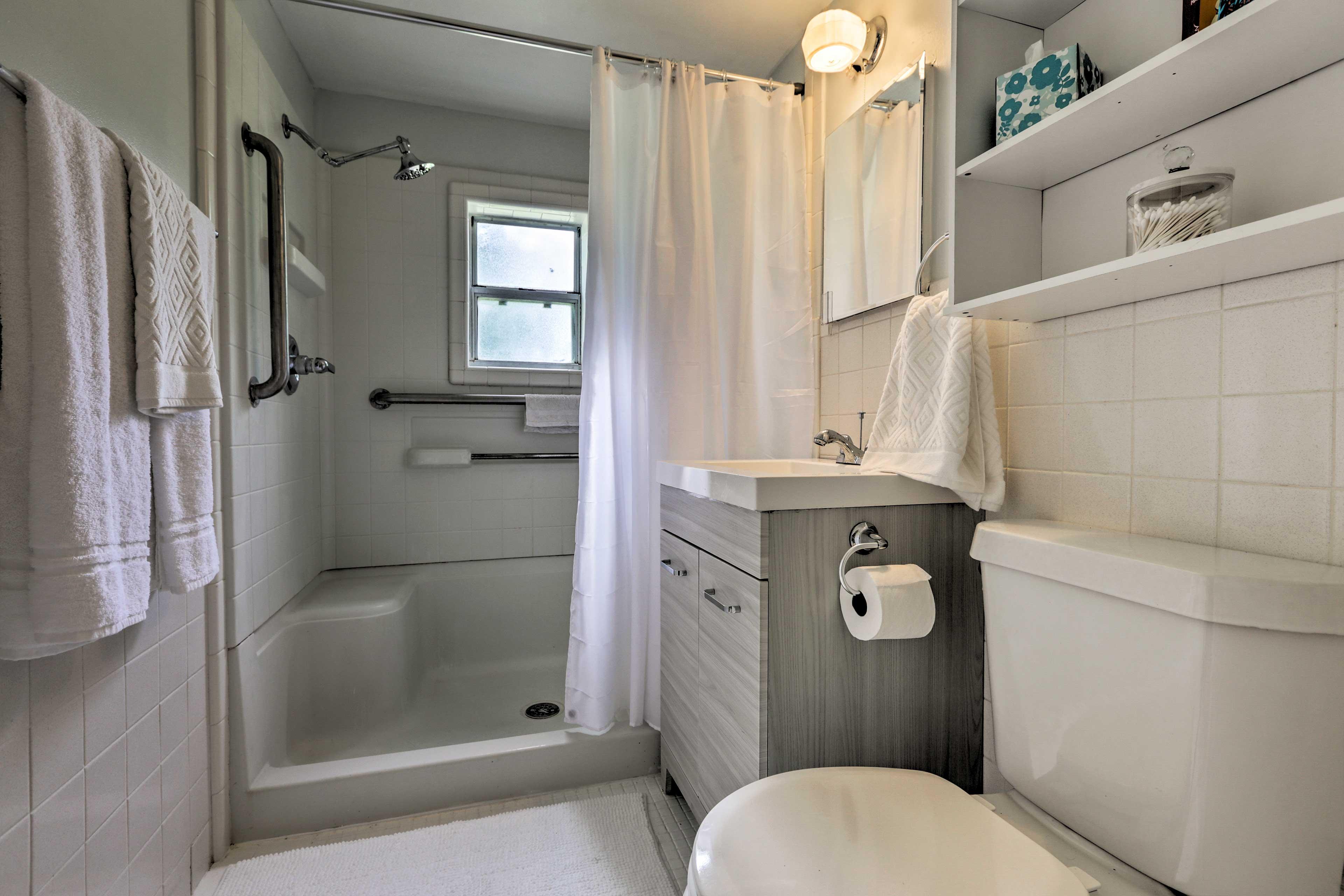 Rinse off under the walk-in shower.