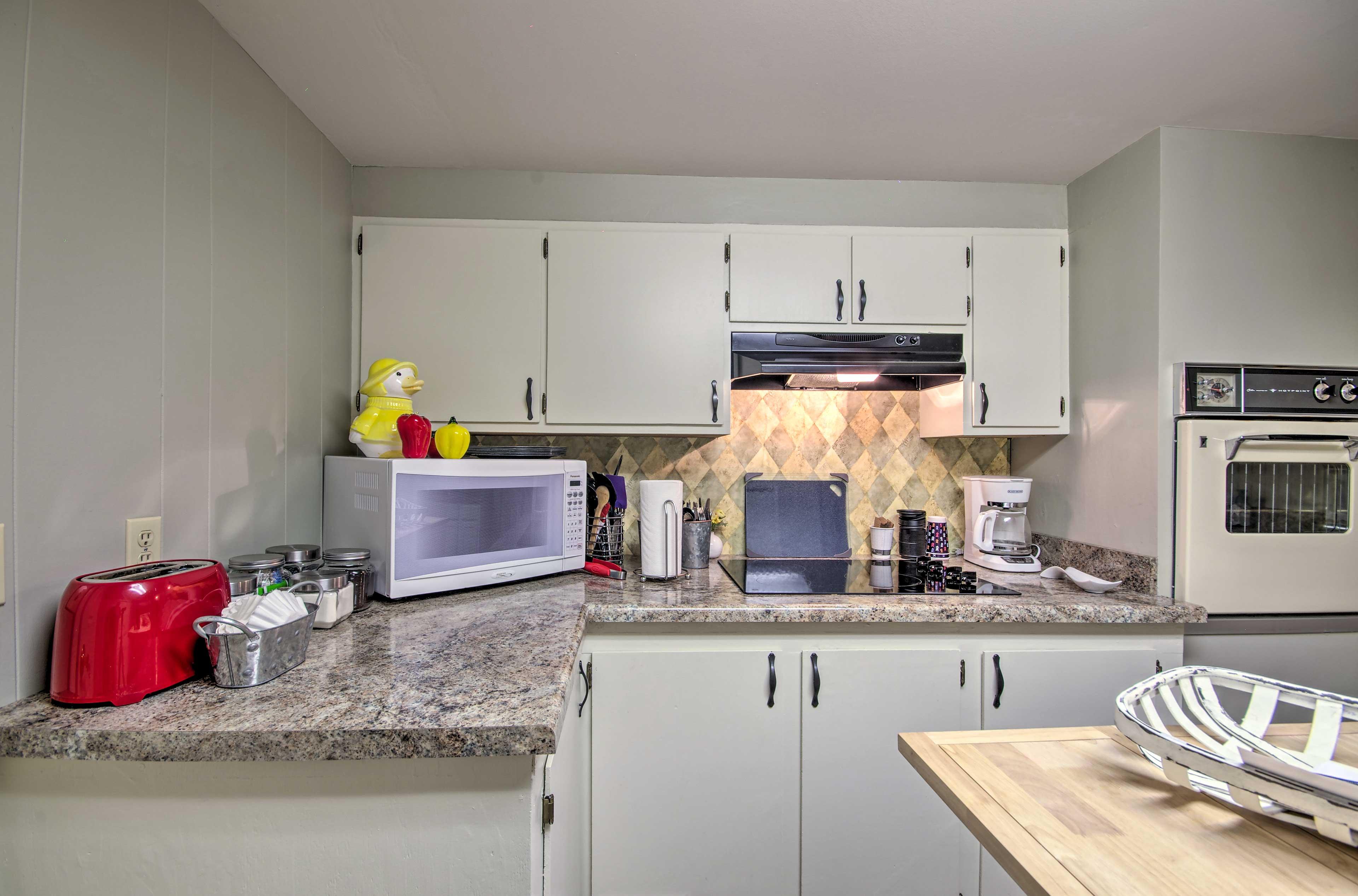 Utilize the kitchen island and granite countertops.