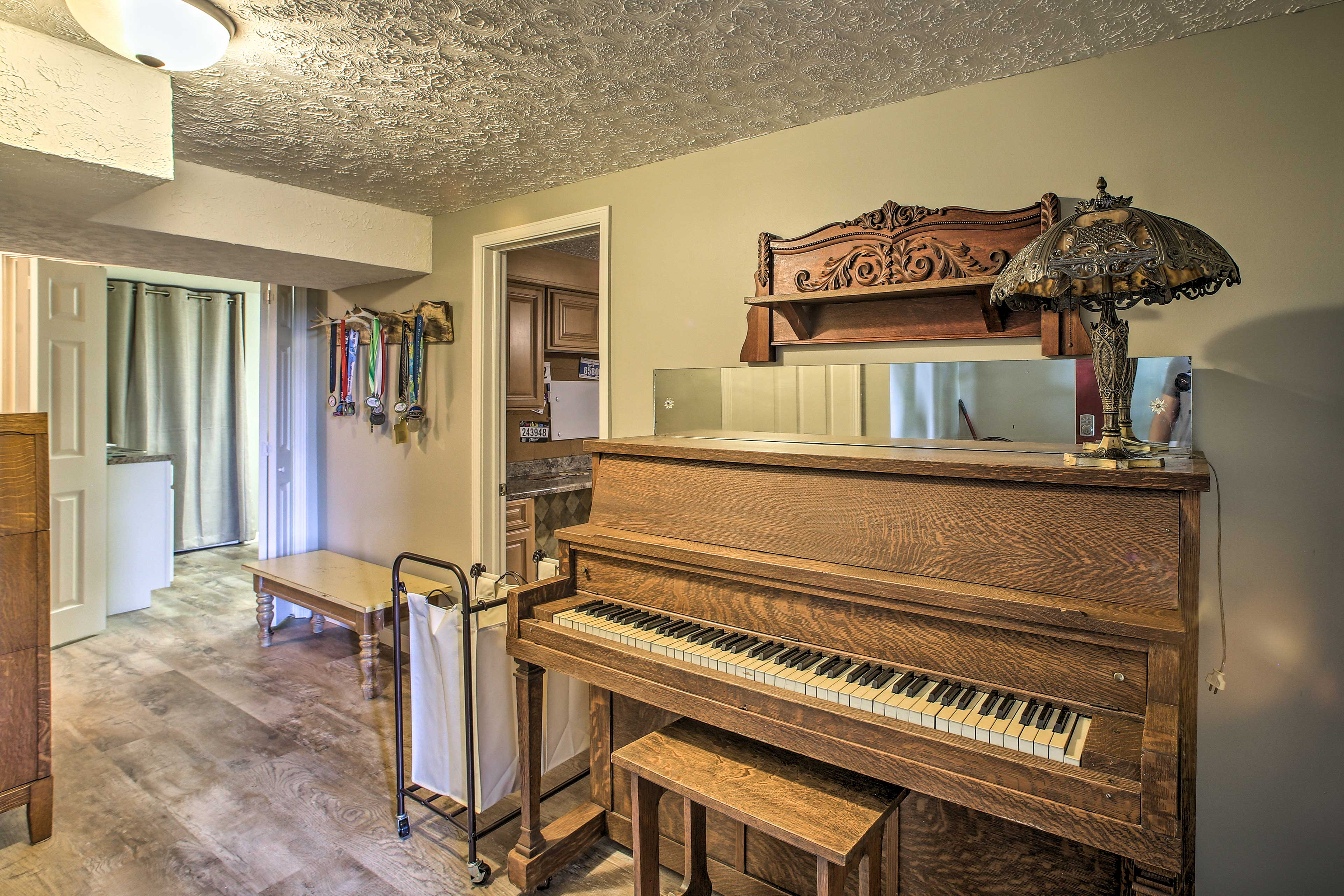 Play a tune for friends on the piano in the entryway.