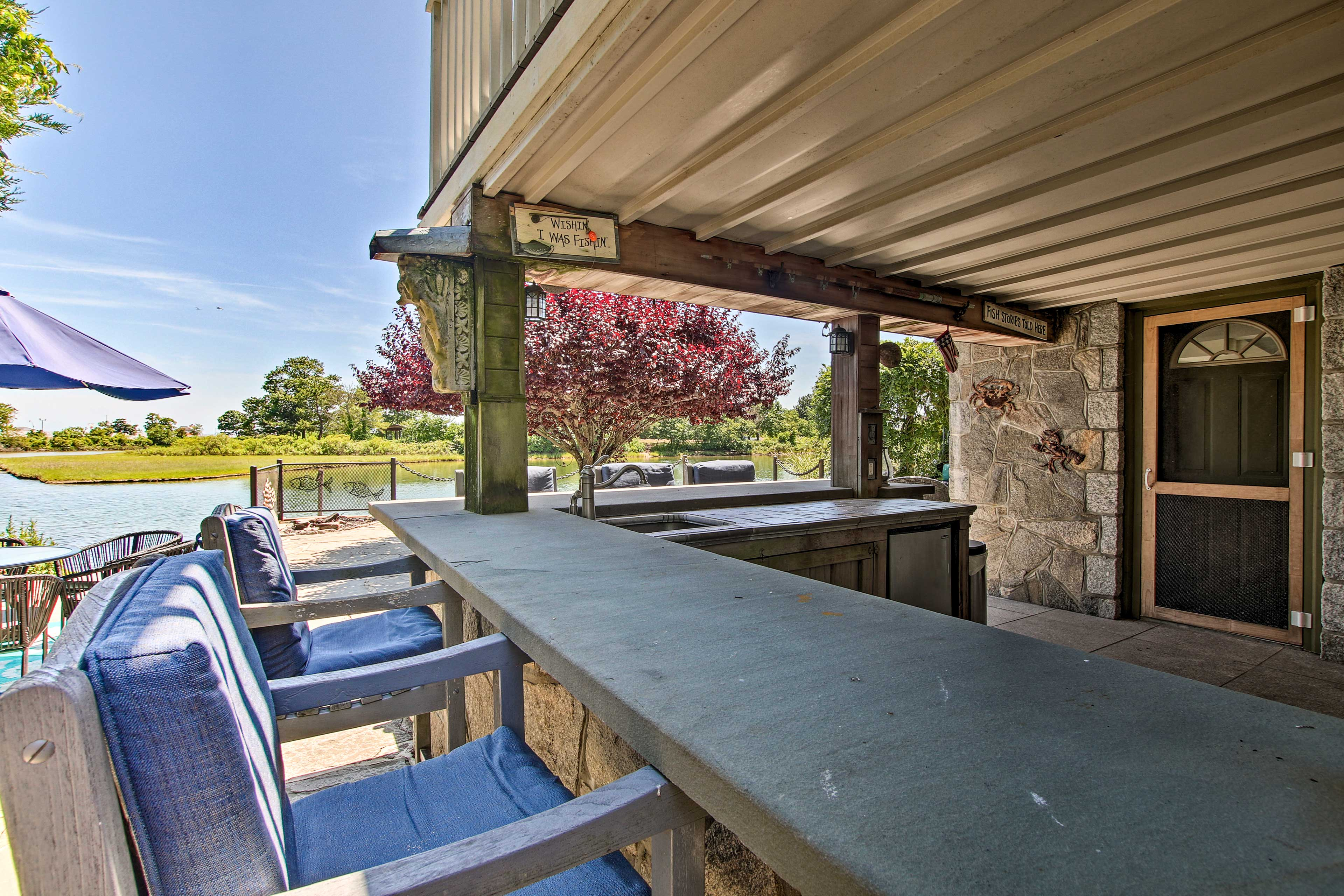This outdoor kitchen with seating makes it easy to entertain.