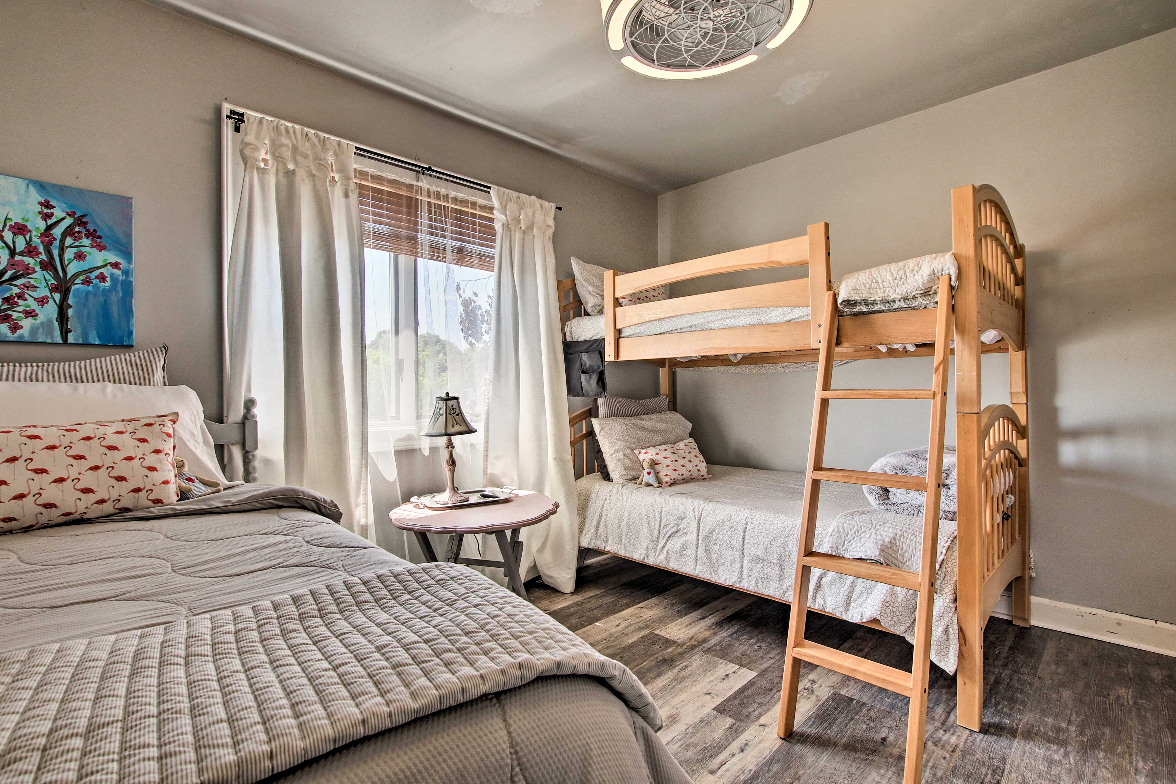 Kids will love sharing this room with a twin bunk bed!