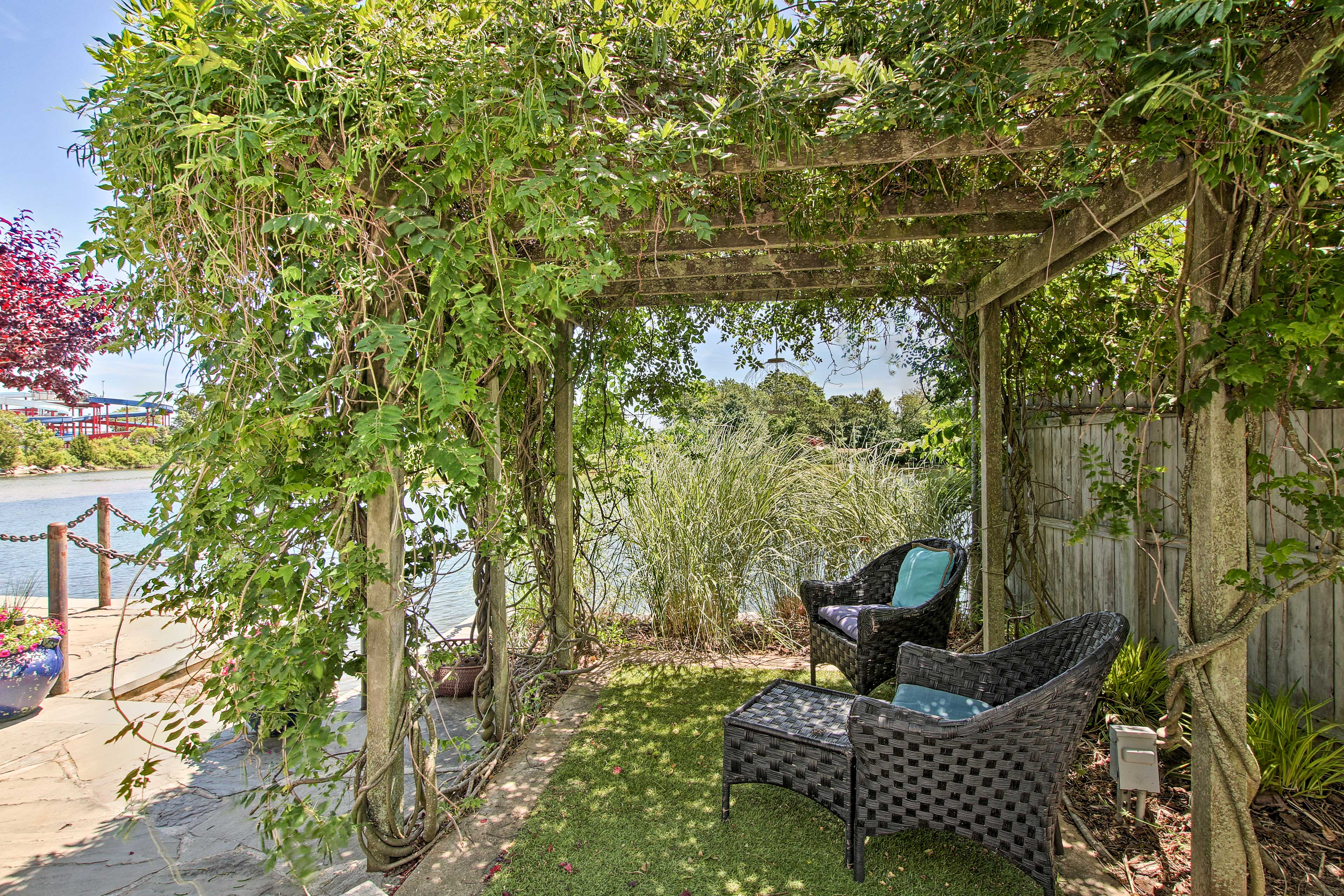 This inviting pergola is covered with greenery!