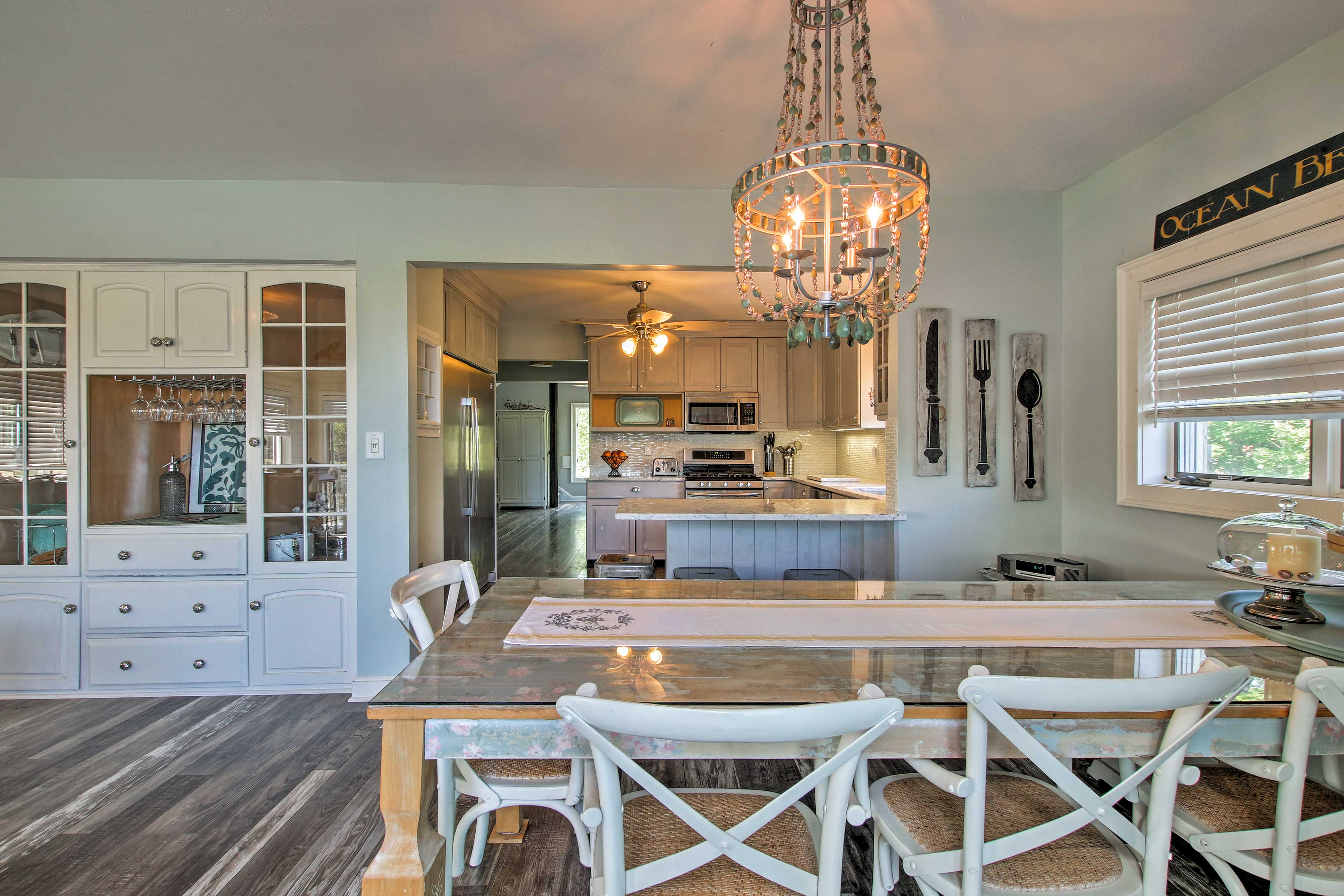 A unique chandelier highlights the dining area.
