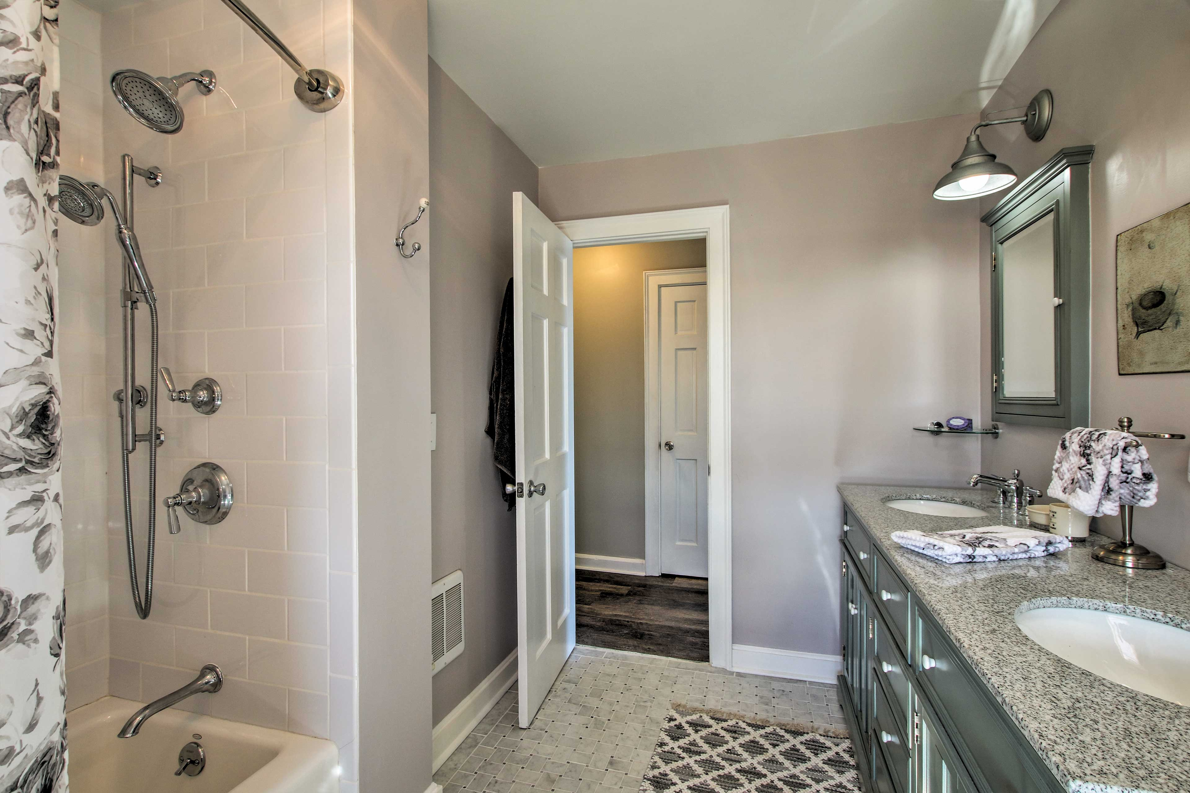 Guests can easily get ready using the second bathroom's shower/tub combo.