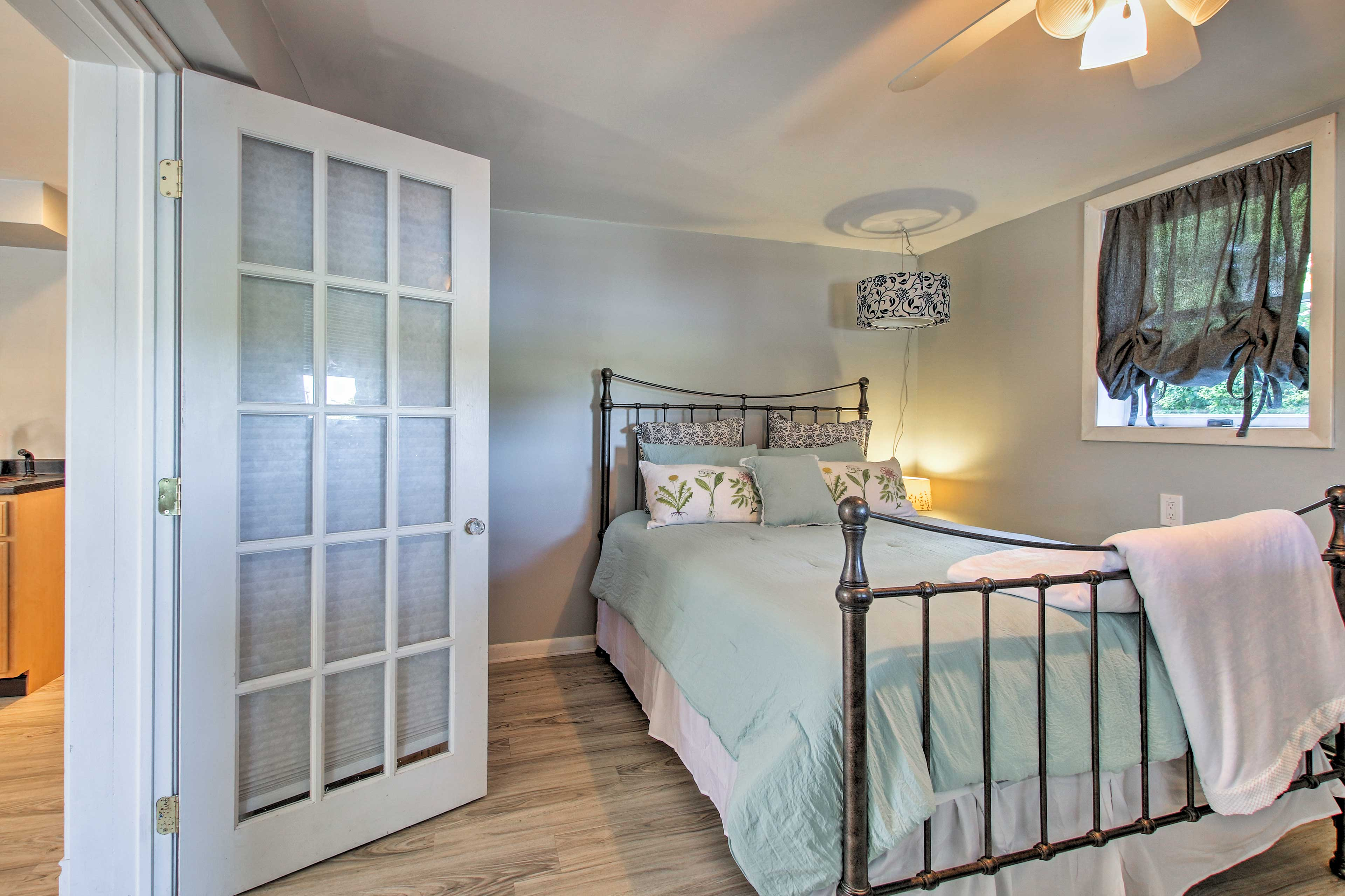 The lower level hosts a bedroom with a full bed.