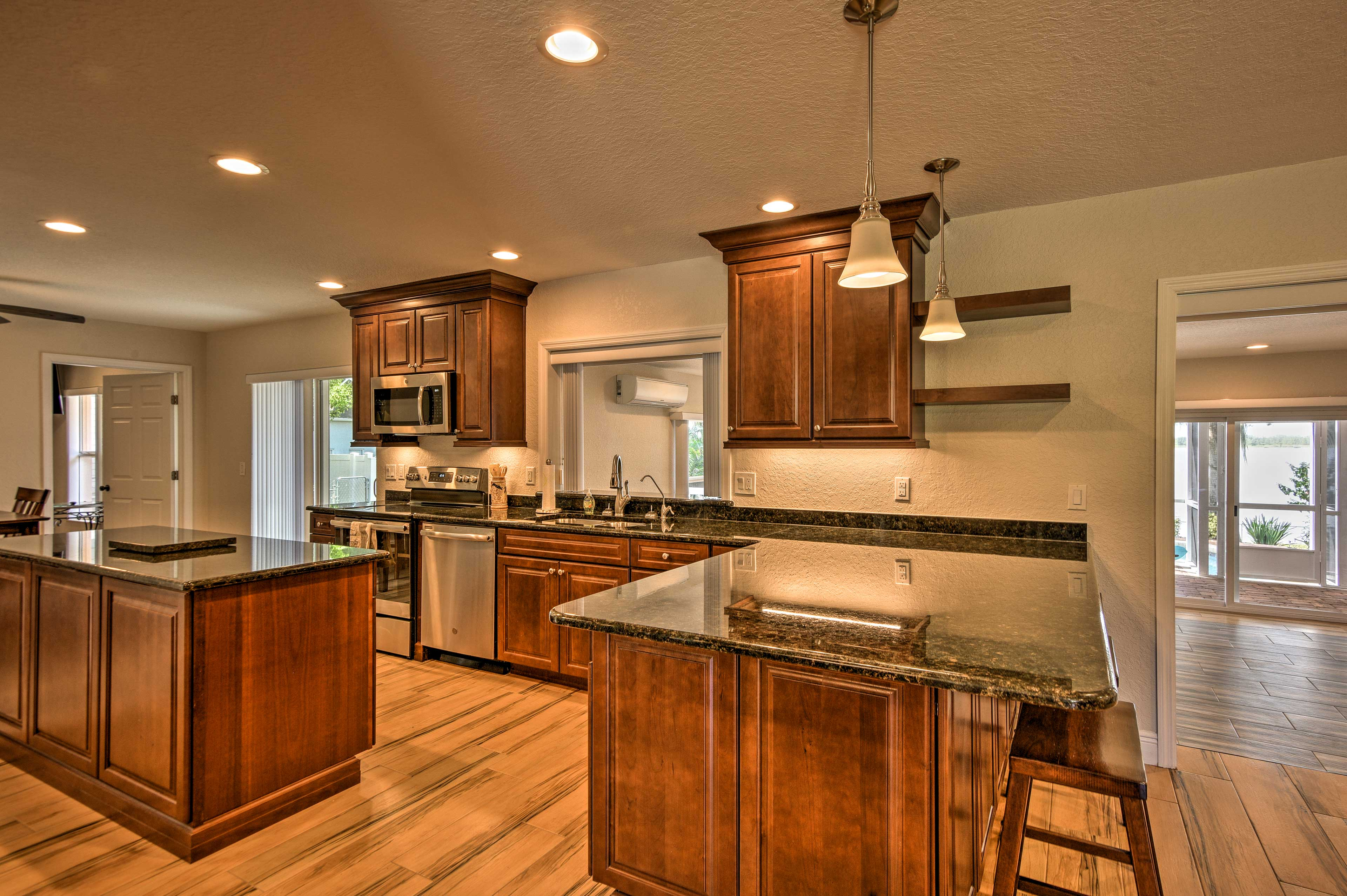 Stainless steep appliances and granite counters highlight the kitchen.