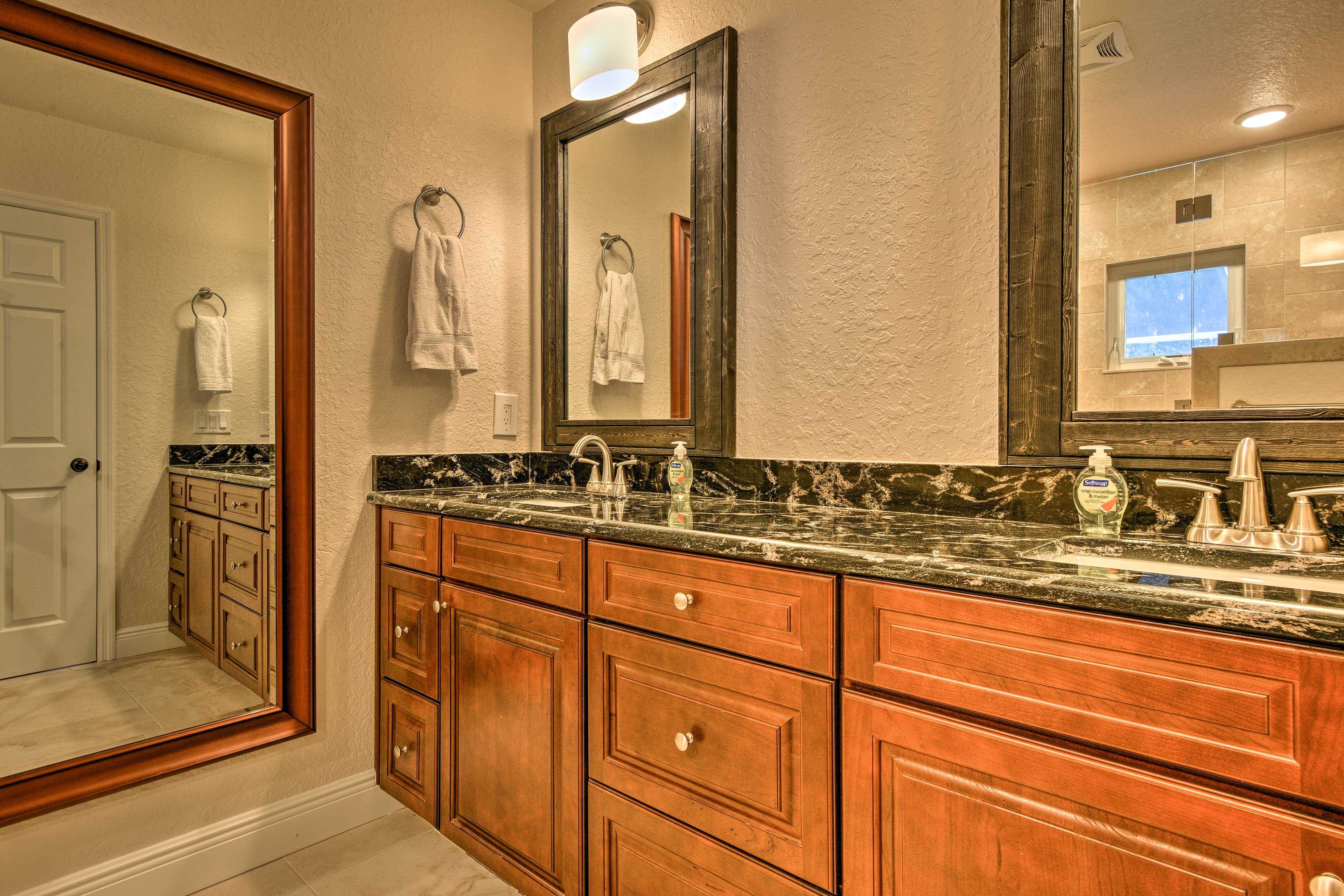 Store your toiletries on the dual vanities of this spacious en-suite bath.