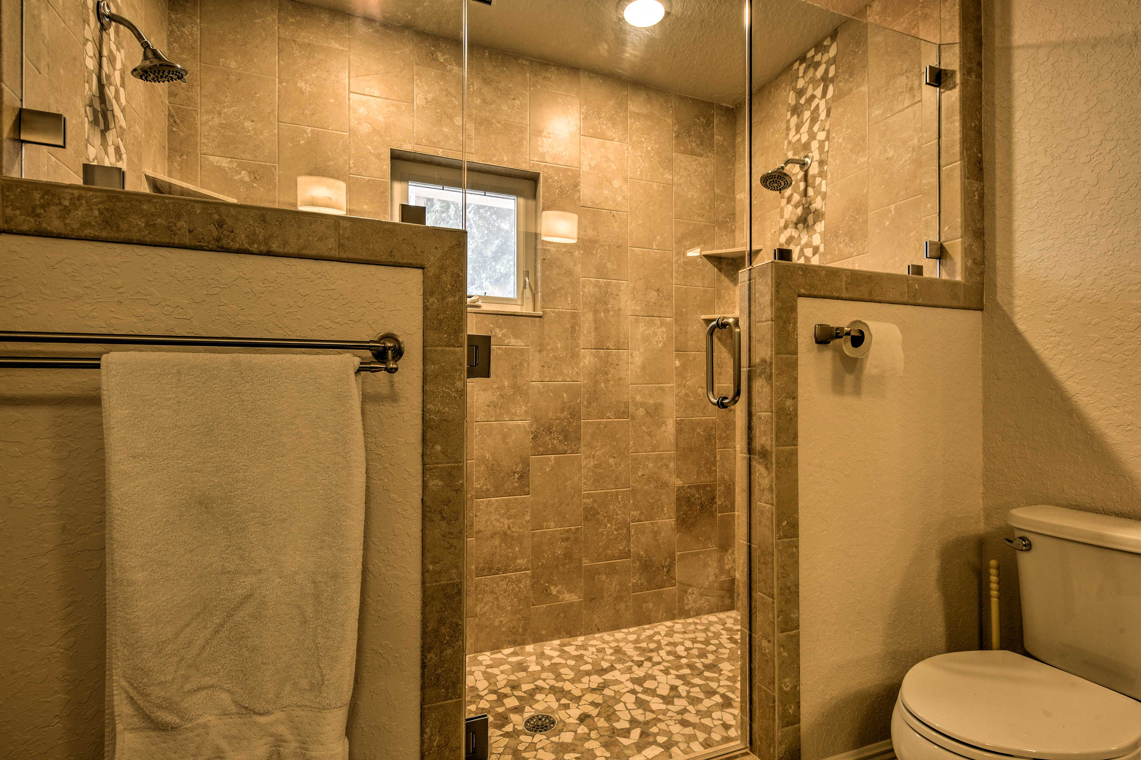 The luxury walk-in shower features dual shower heads!