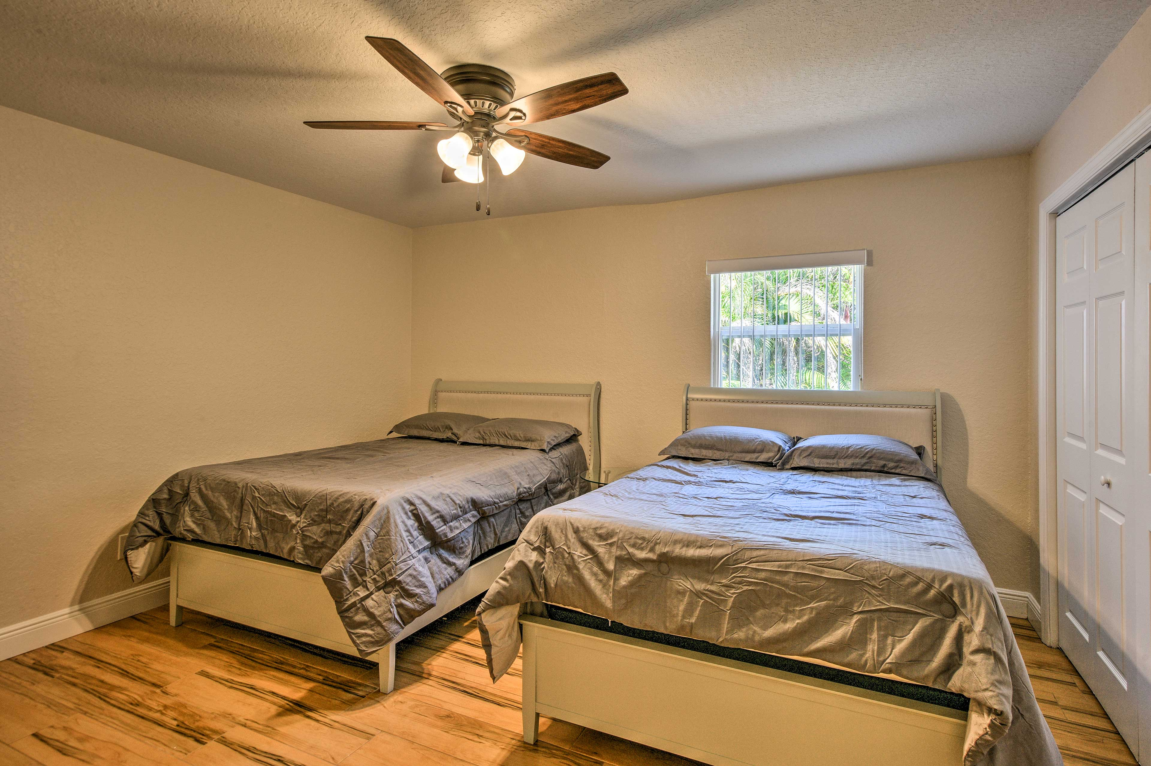 This bedroom is perfect for kids with its 2 queen beds.