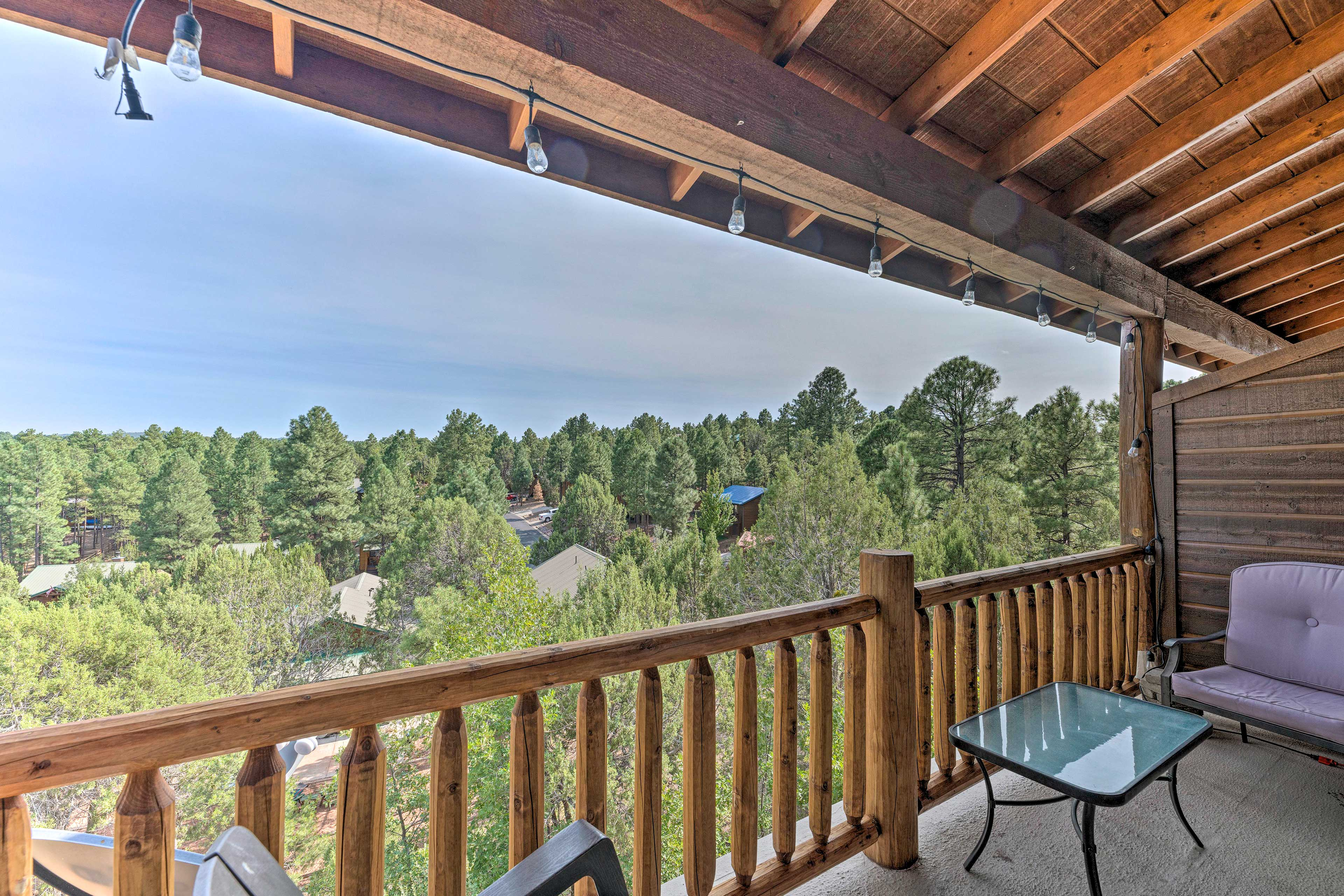Sip your morning coffee on the covered balcony overlooking the pines.