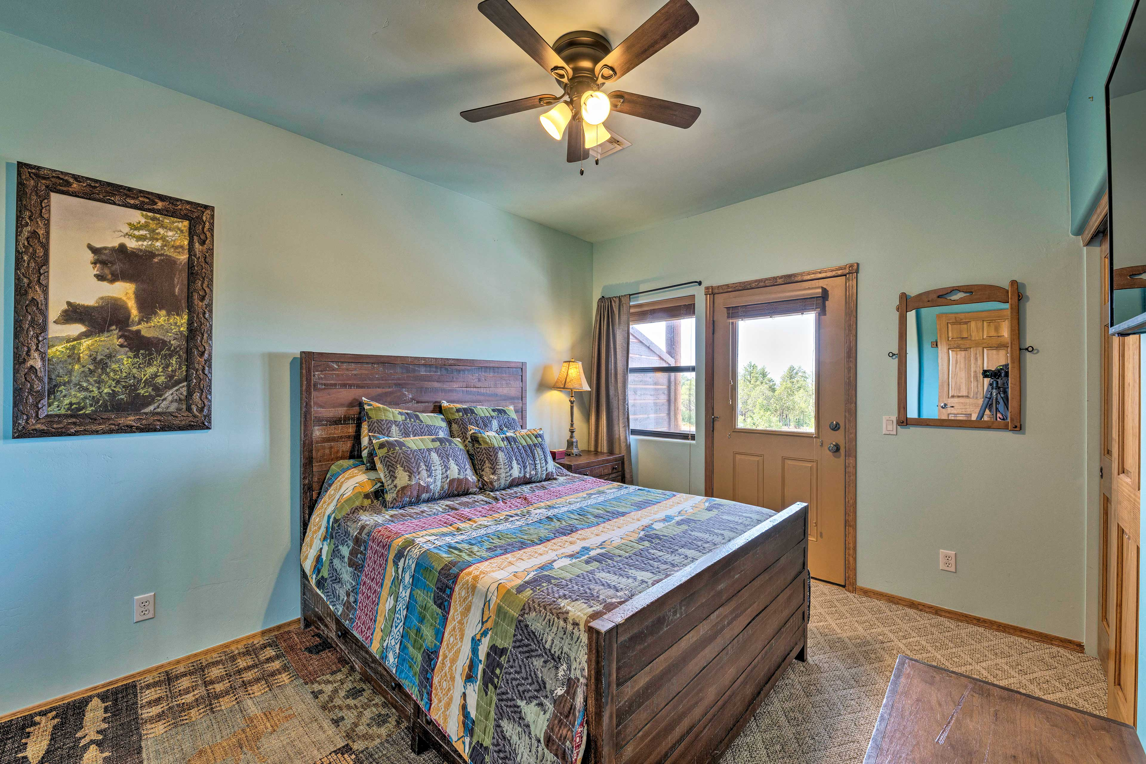 The master bedroom features a queen bed and a rollaway for extra sleep space.